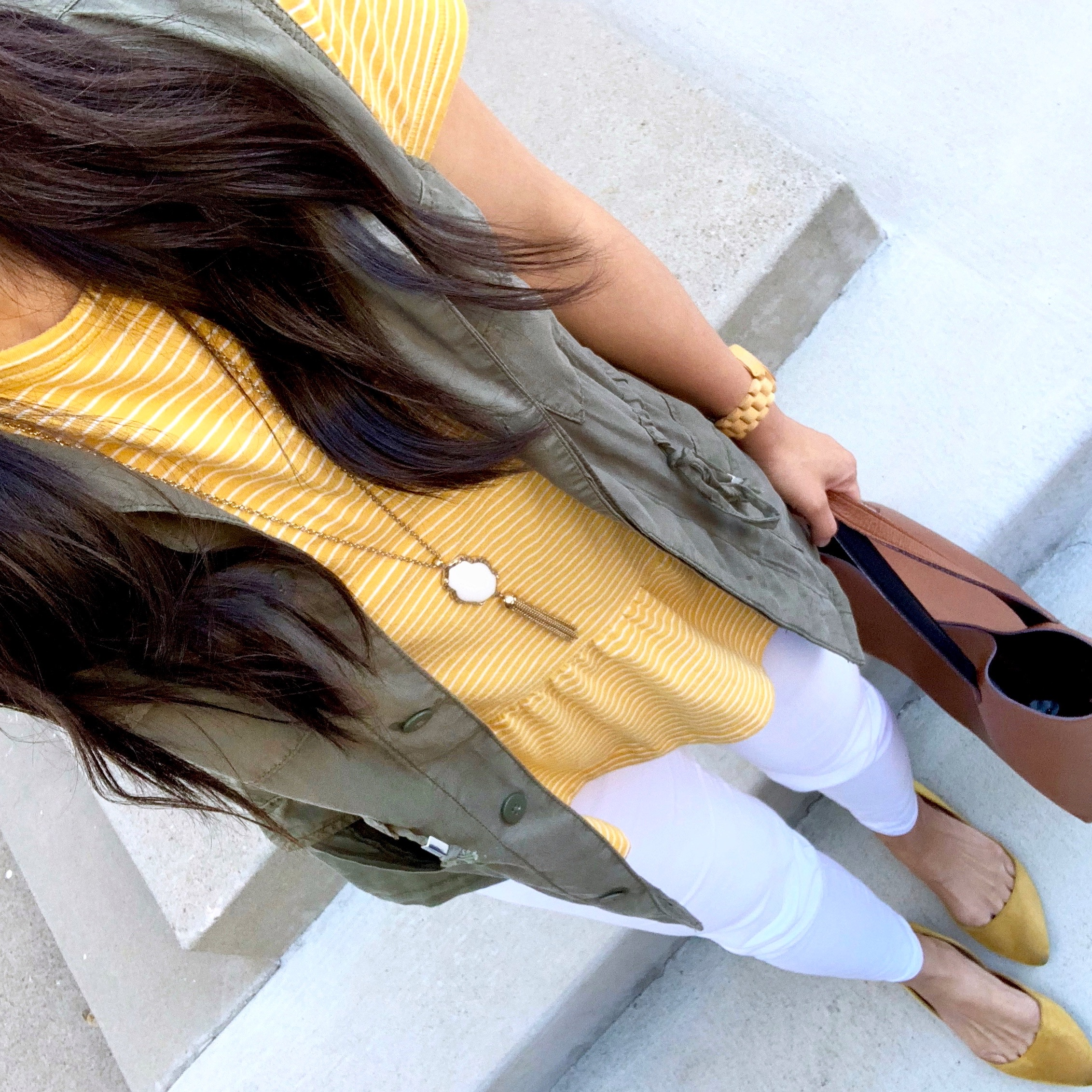 yellow striped tee + olive utility vest + white pants + yellow flats