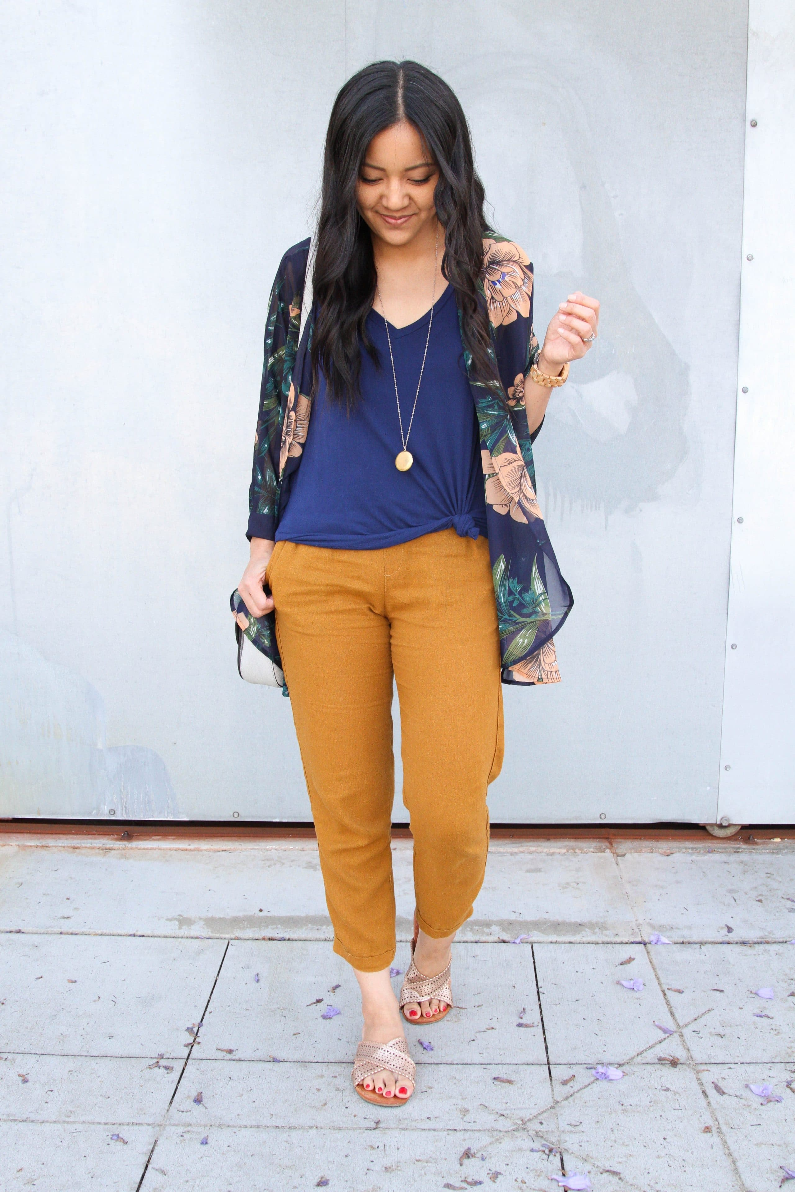 navy top + mustard linen pants + navy floral wrap + metallic sandals + pendant necklace