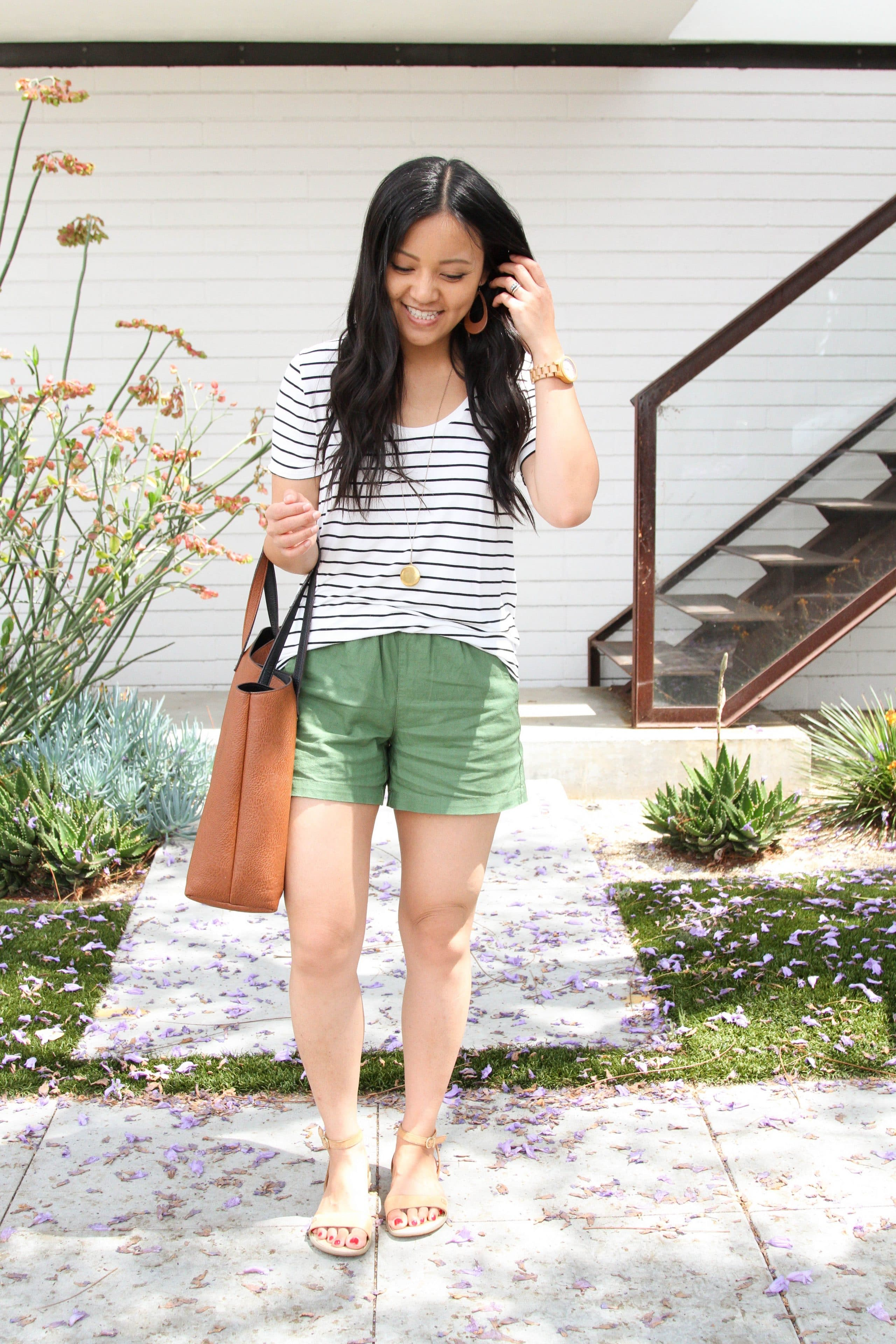 stripped tee + olive shorts + tan sandals + brown tote + long pendant necklace