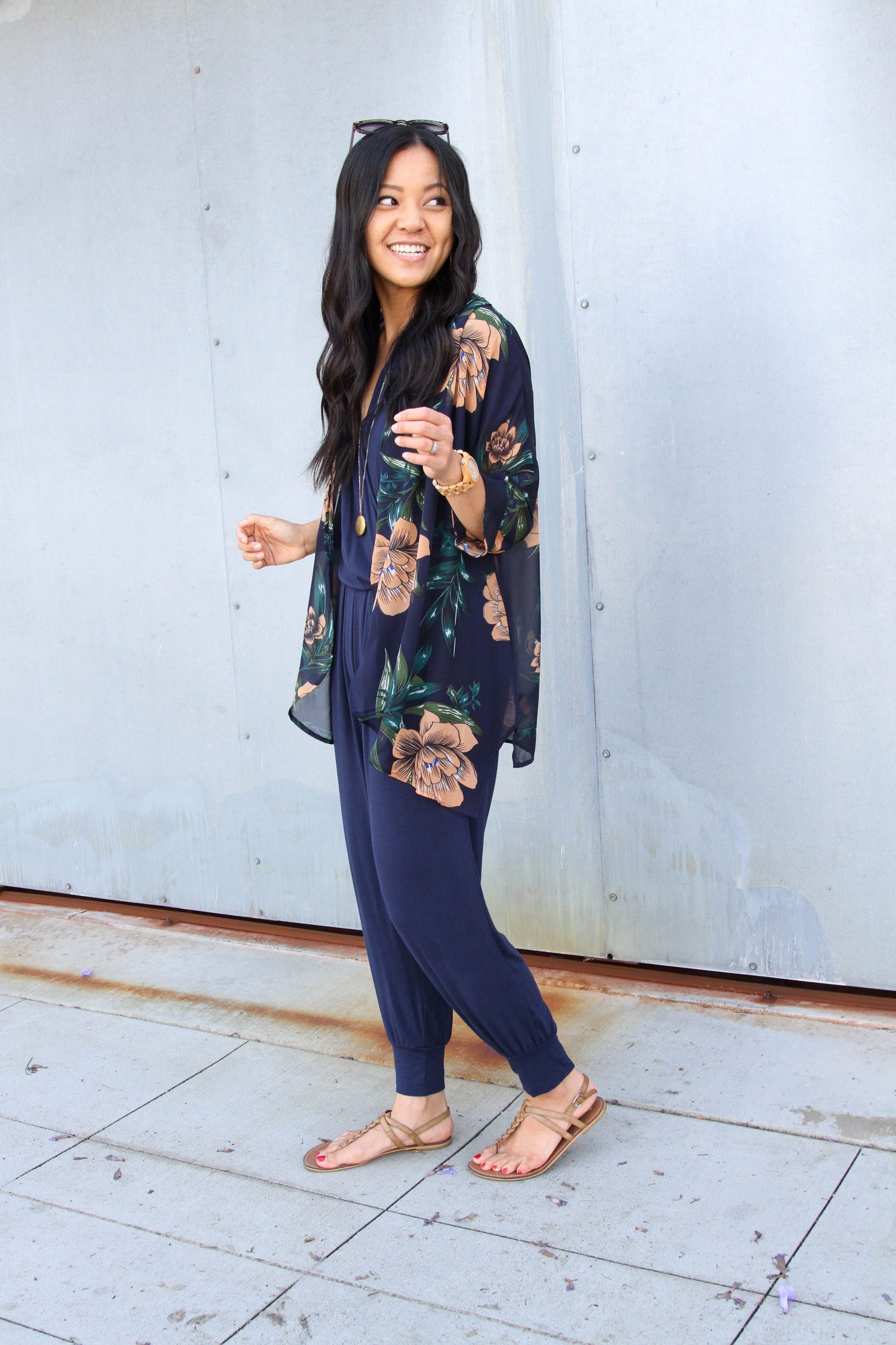 navy jumpsuit + floral wrap + tan sandals