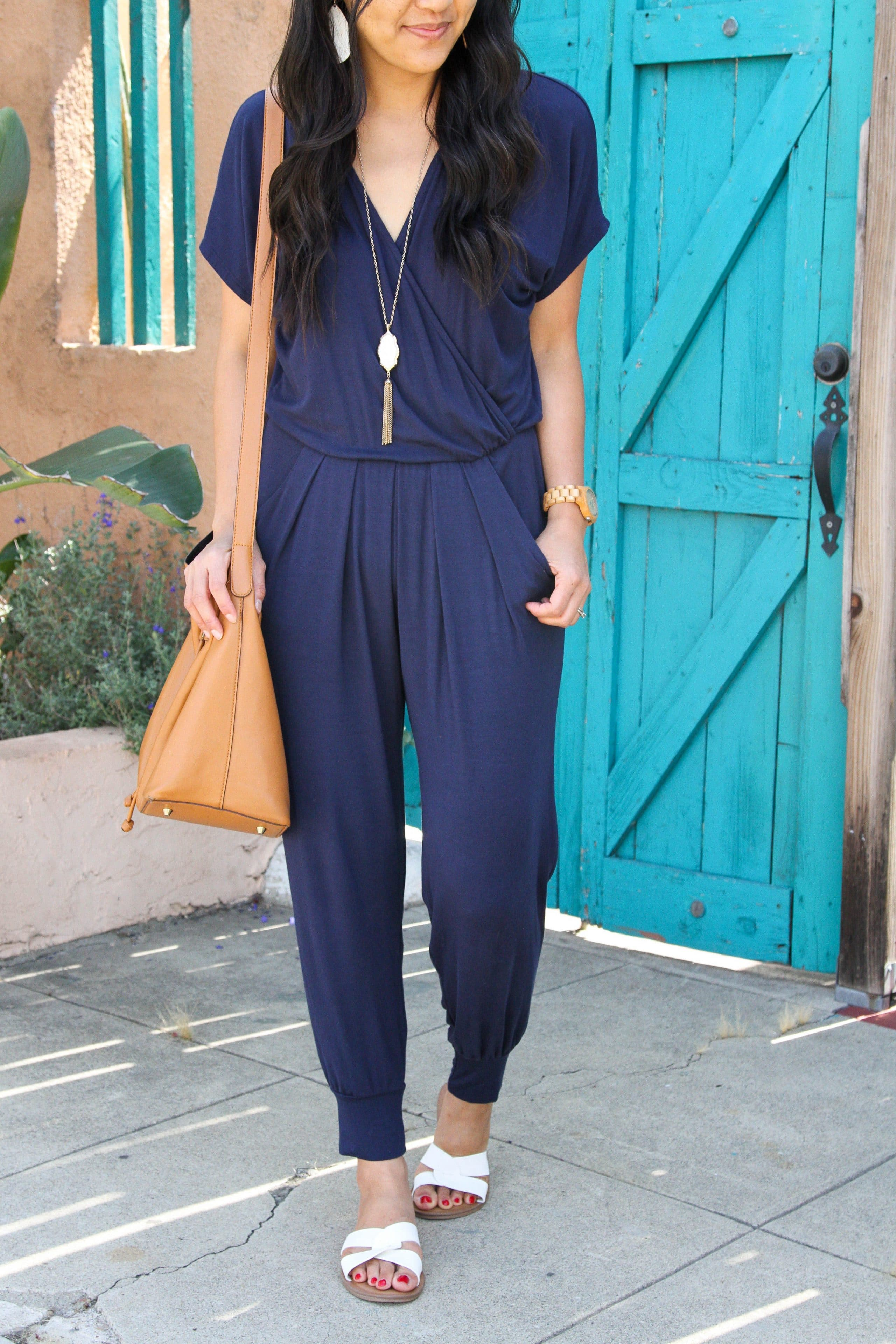 white sandals + cognac tote + navy jumpsuit