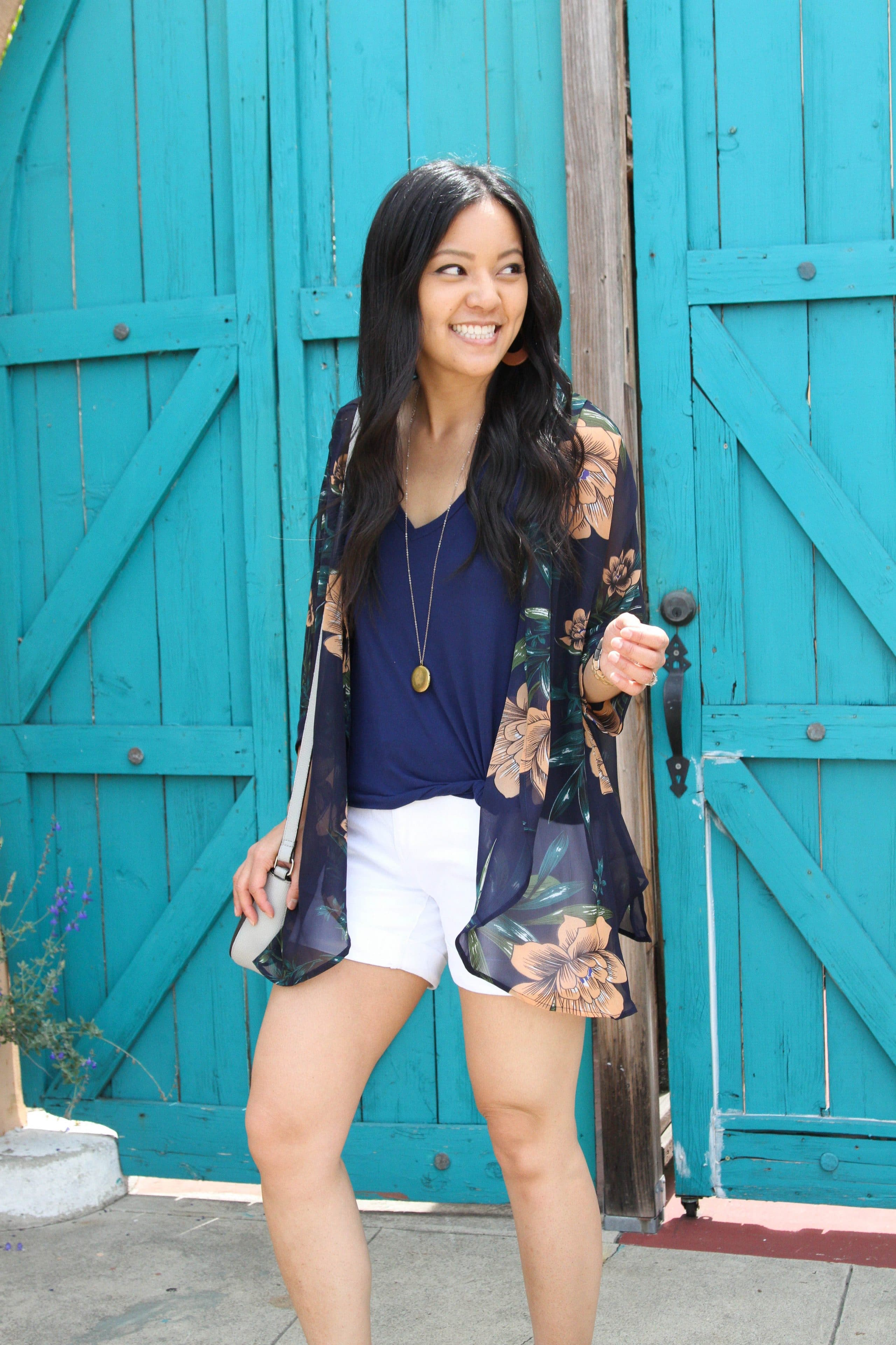 navy top + white shorts + long pendant necklace + navy floral wrap