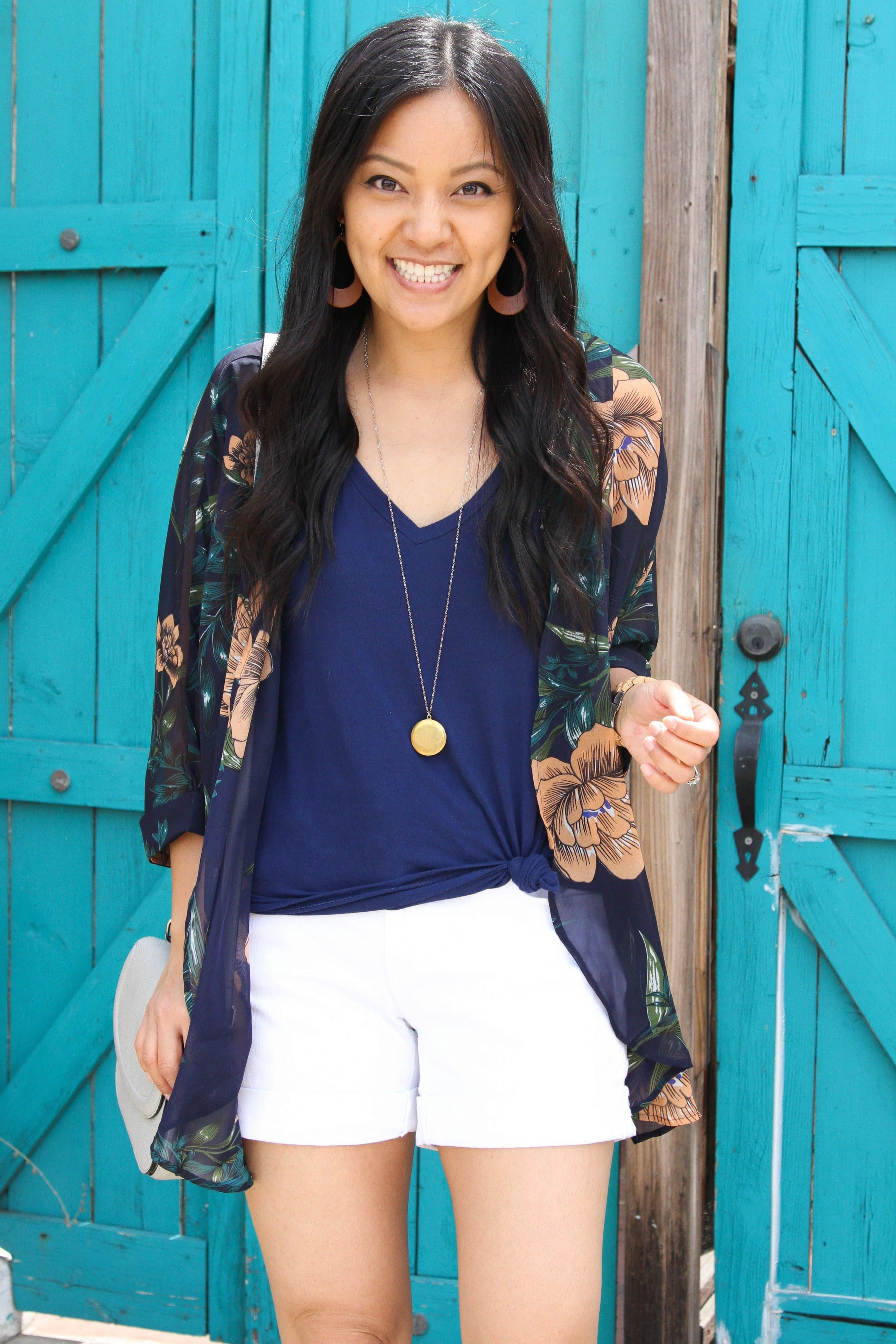 navy top + white shorts + navy floral wrap + long pendant necklace