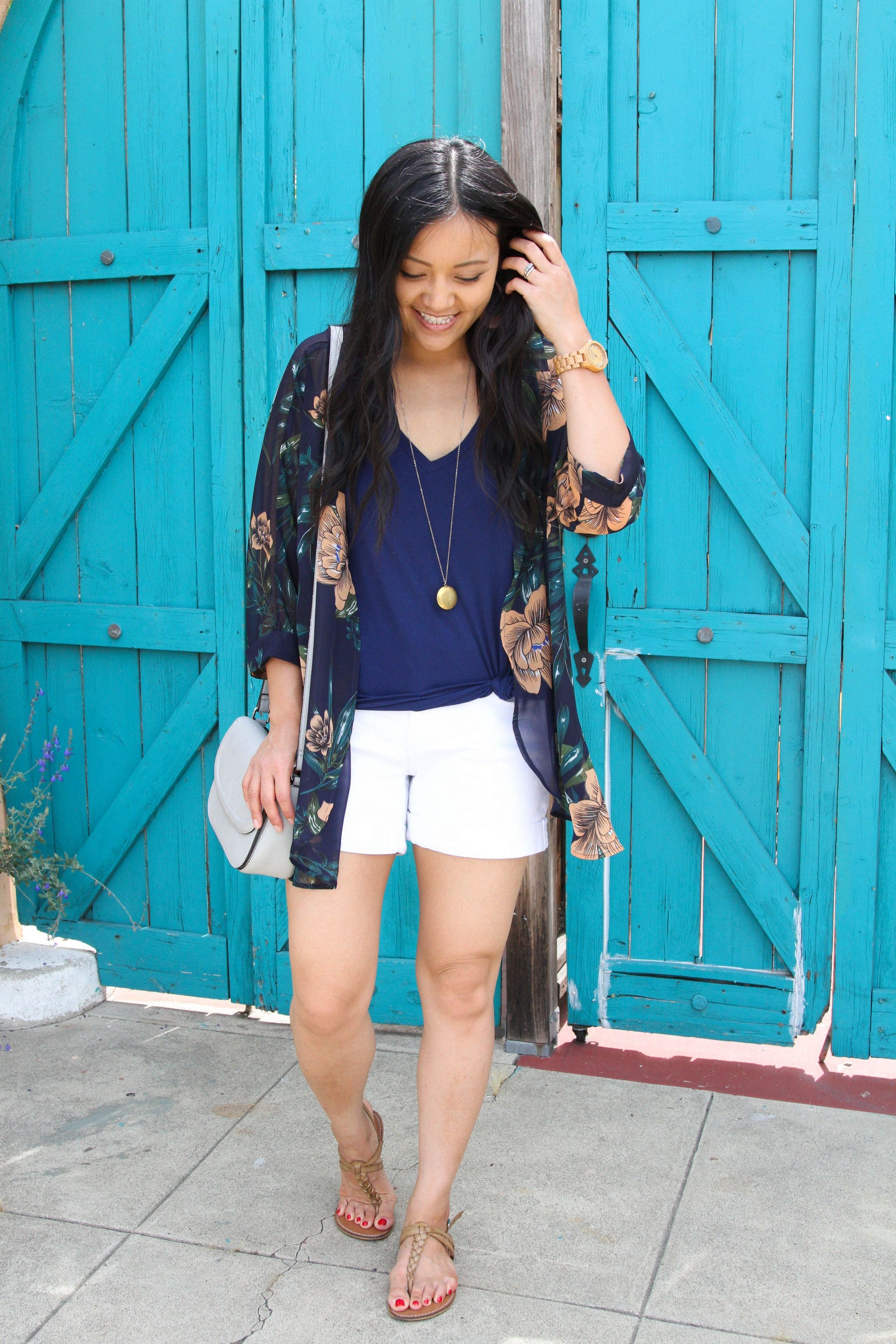 navy top + white shorts + navy floral wrap + long pendant necklace + tan sandals