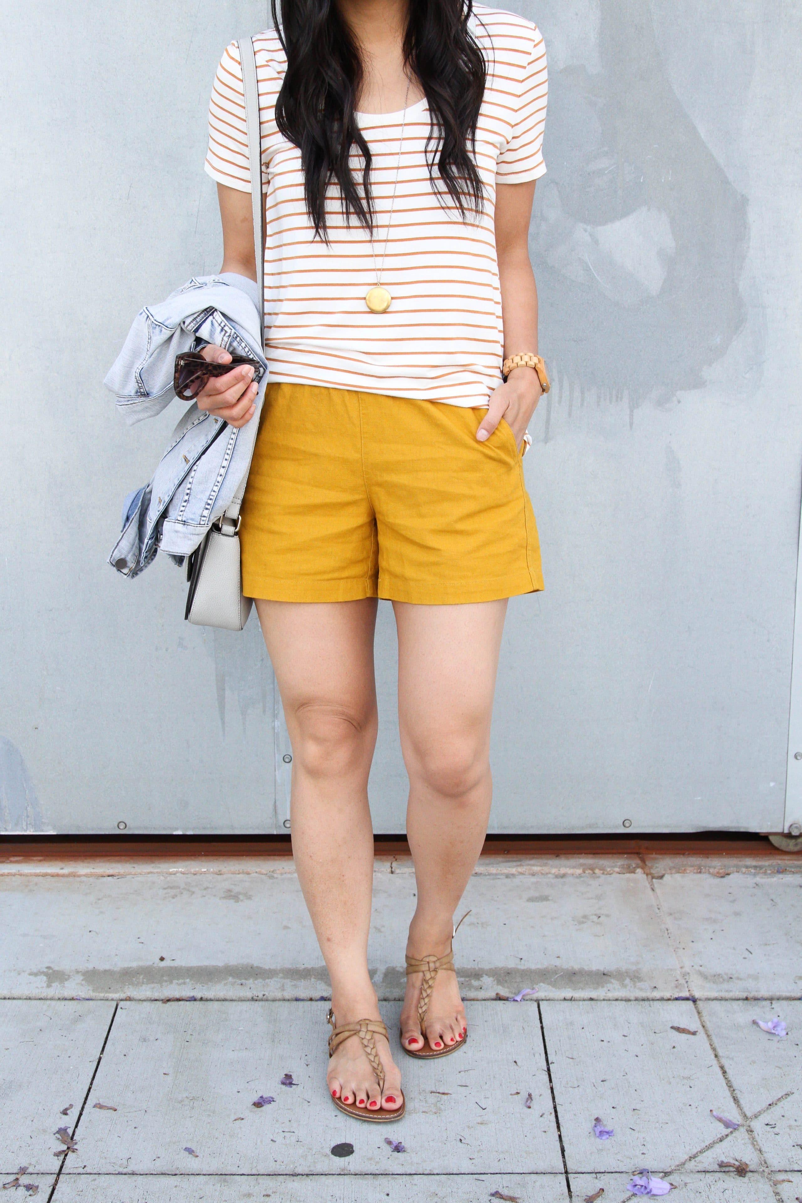 striped tee + mustard shorts + tan sandals + denim jacket