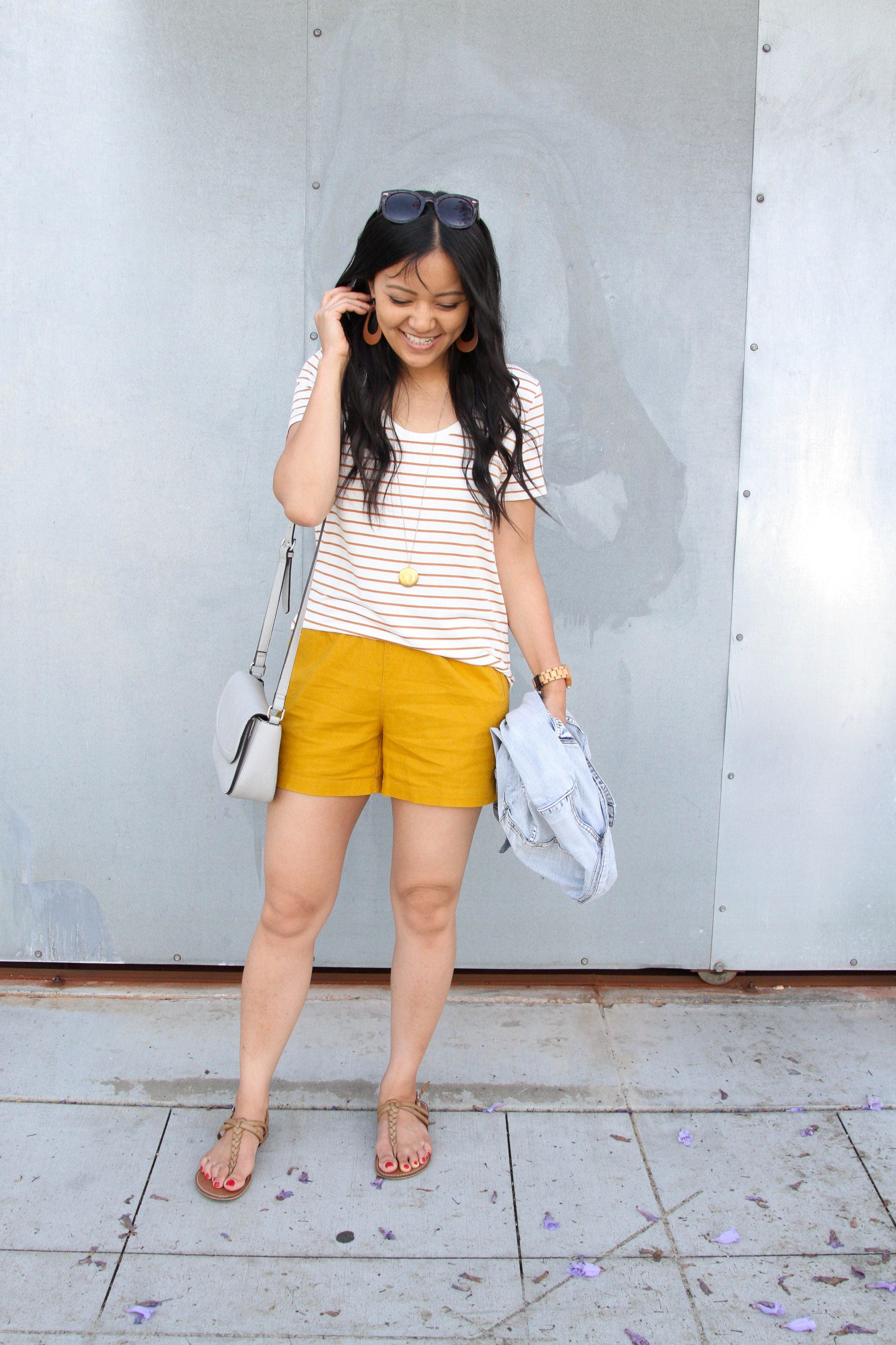 mustard shorts + striped tee + tan sandals + crossbody purse + denim jacket