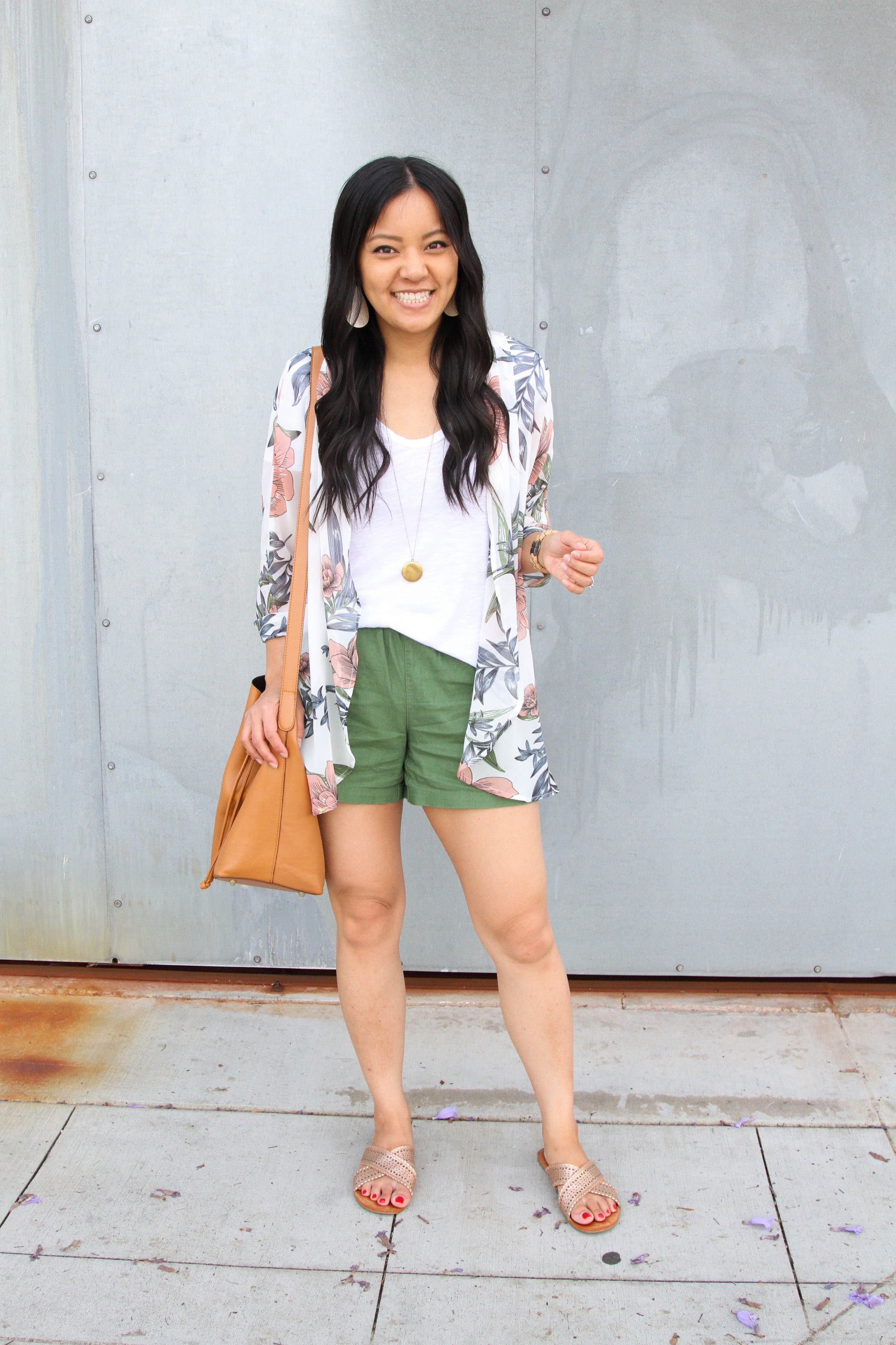 white tee + olive shorts + floral wrap + metallic sandals + tote + long pendant necklace