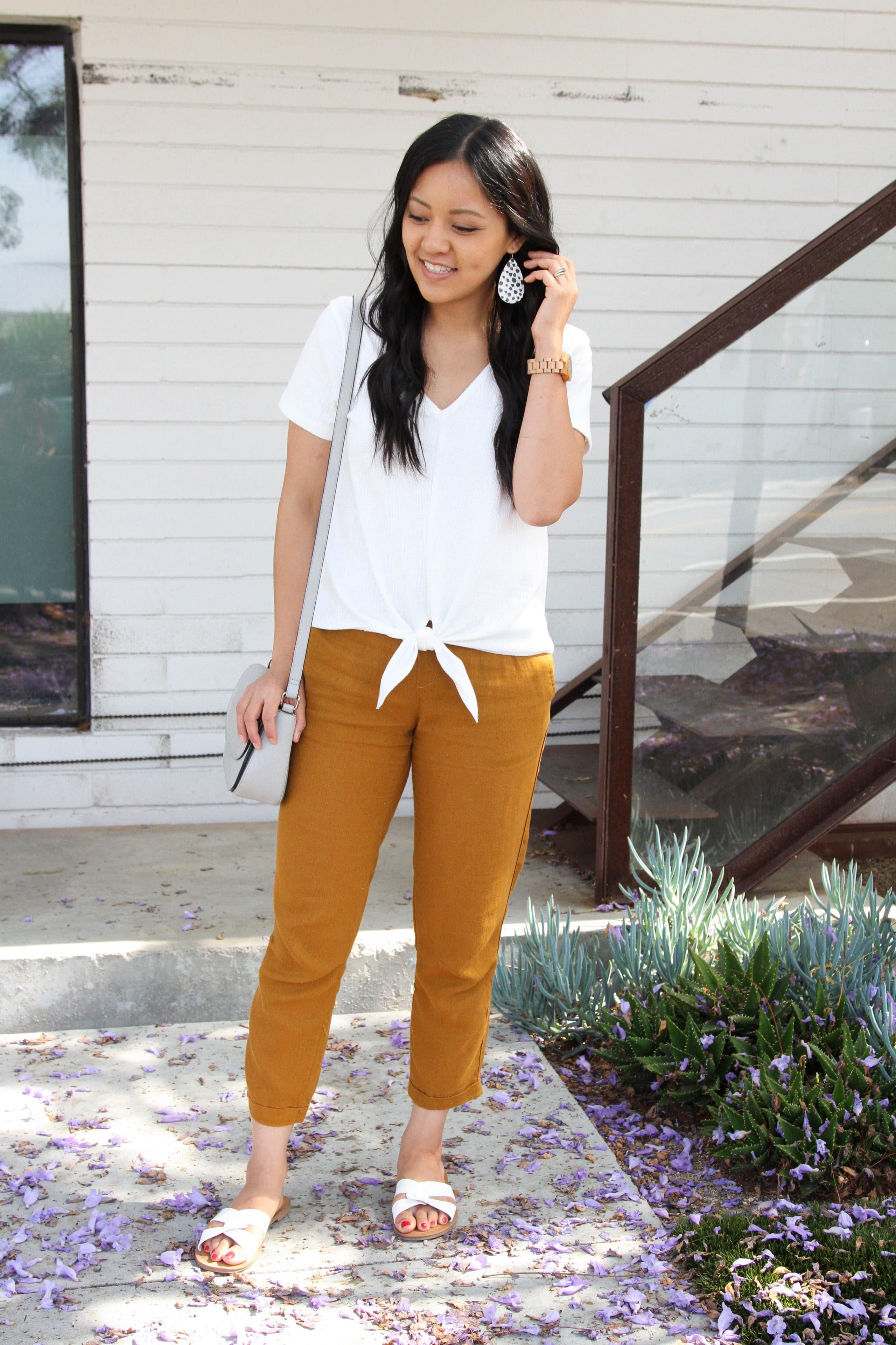 tan linen pants + white tie top + white sandals + leopard print earrings
