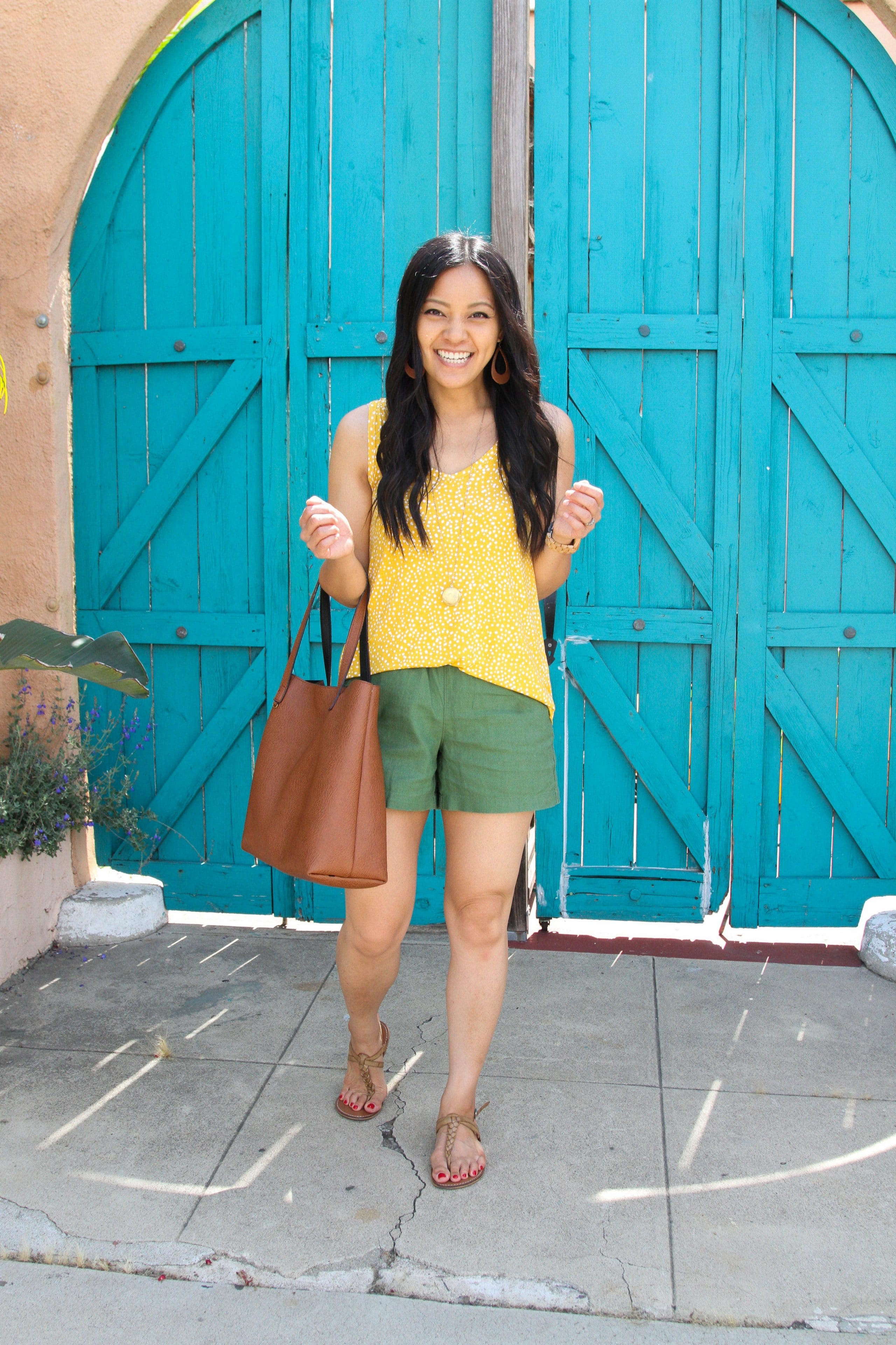 olive shorts + yellow tank top + bag + tan sandals