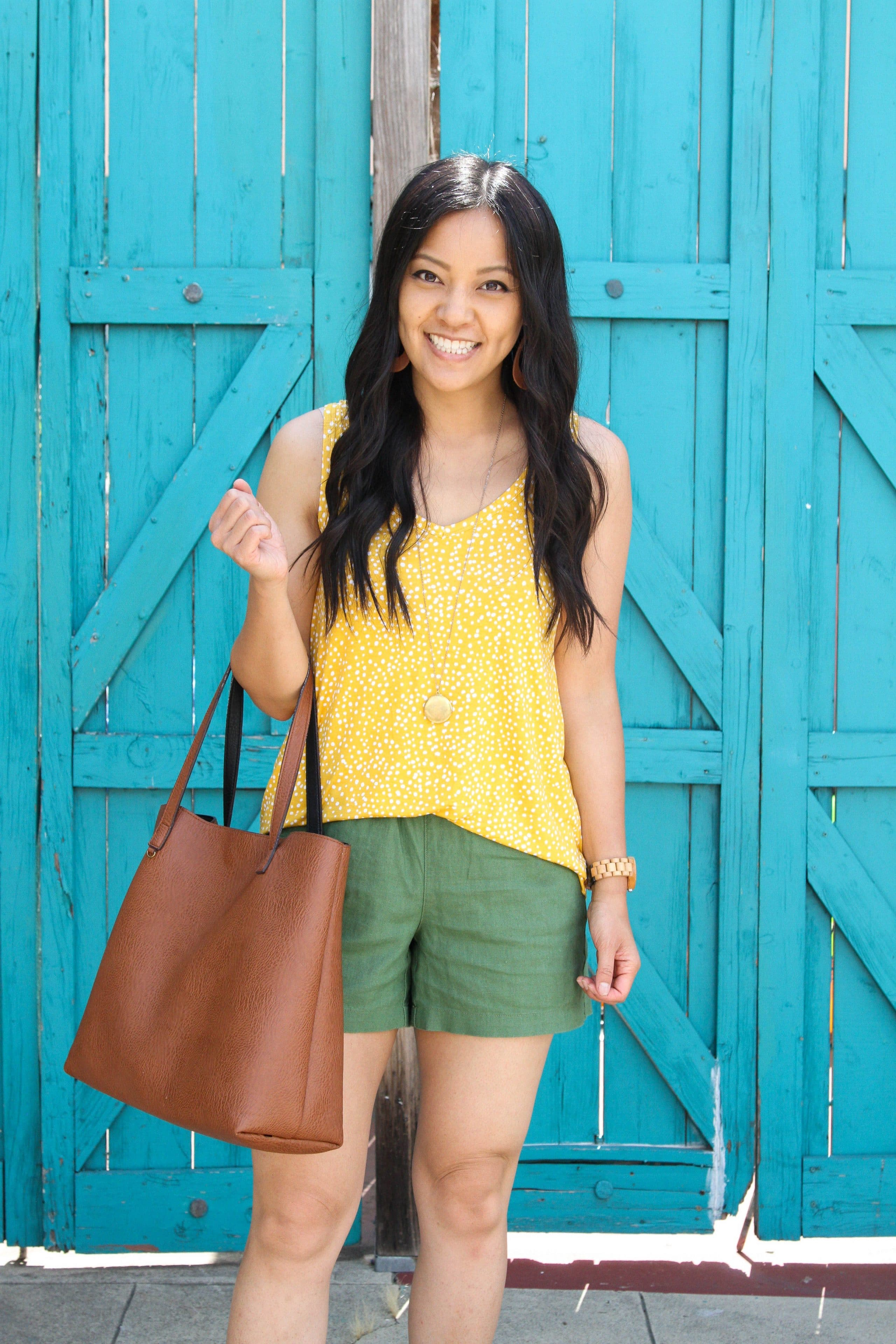 yellow tank top + olive shorts + tote + long pendant necklace