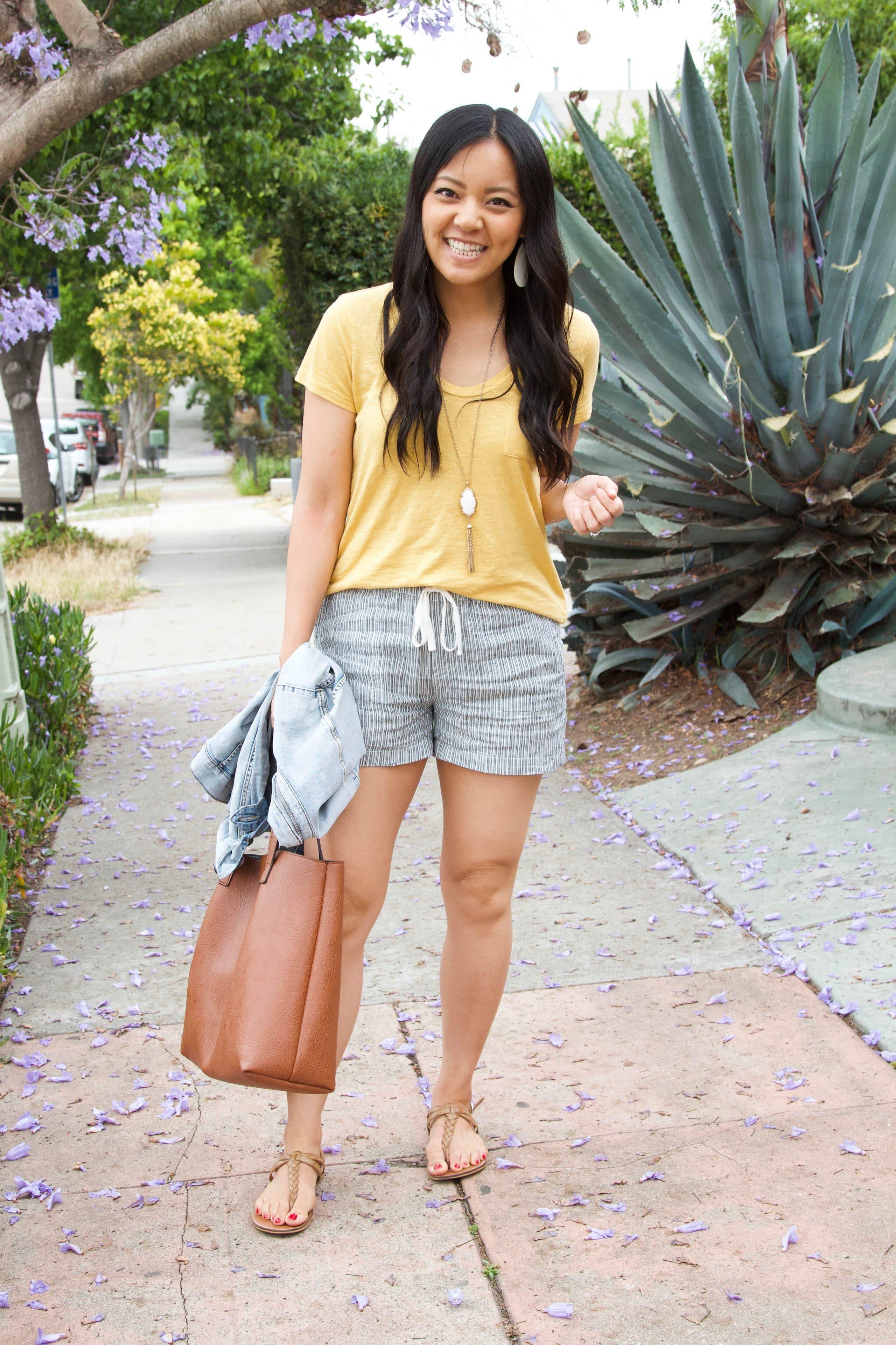 yellow tee + grey shorts + denim jacket + tan sandals + tote