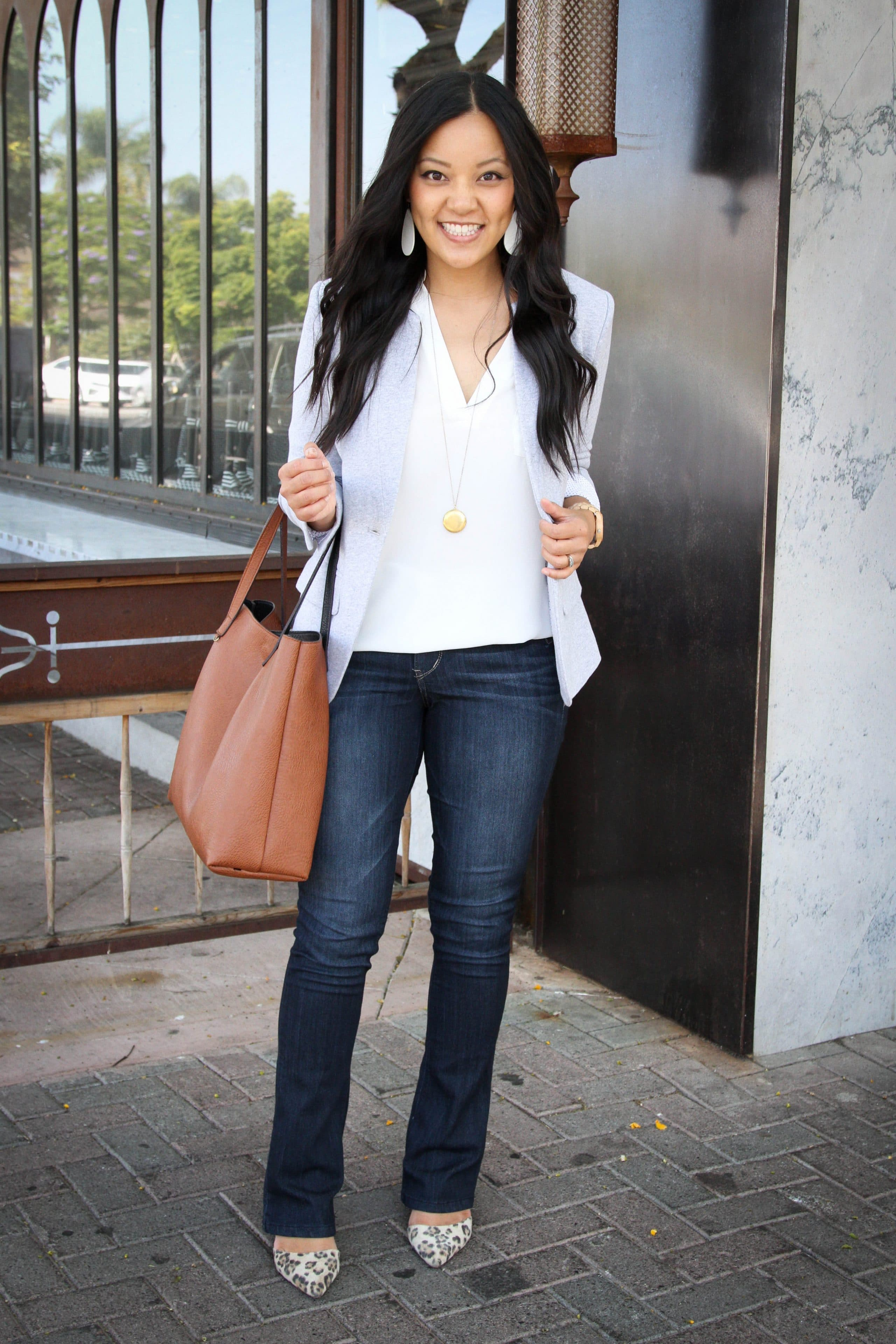 Elevated Casual Outfit: white top + gray blazer + bootcut jeans + white earrings + pendant necklace + tan tote + leopard flats