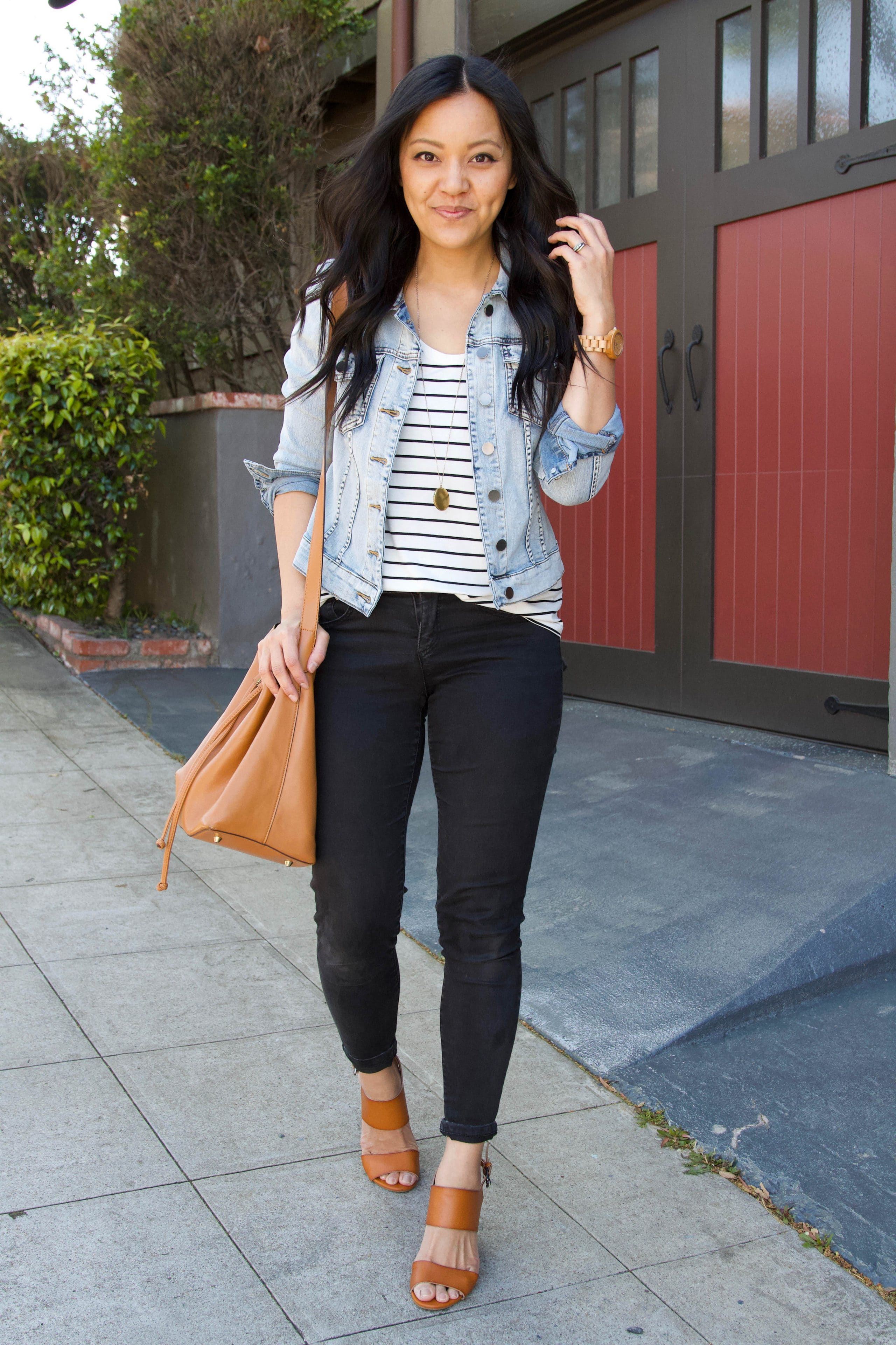 black and white striped tee + black jeans + denim jacket + tan wedges + tan purse