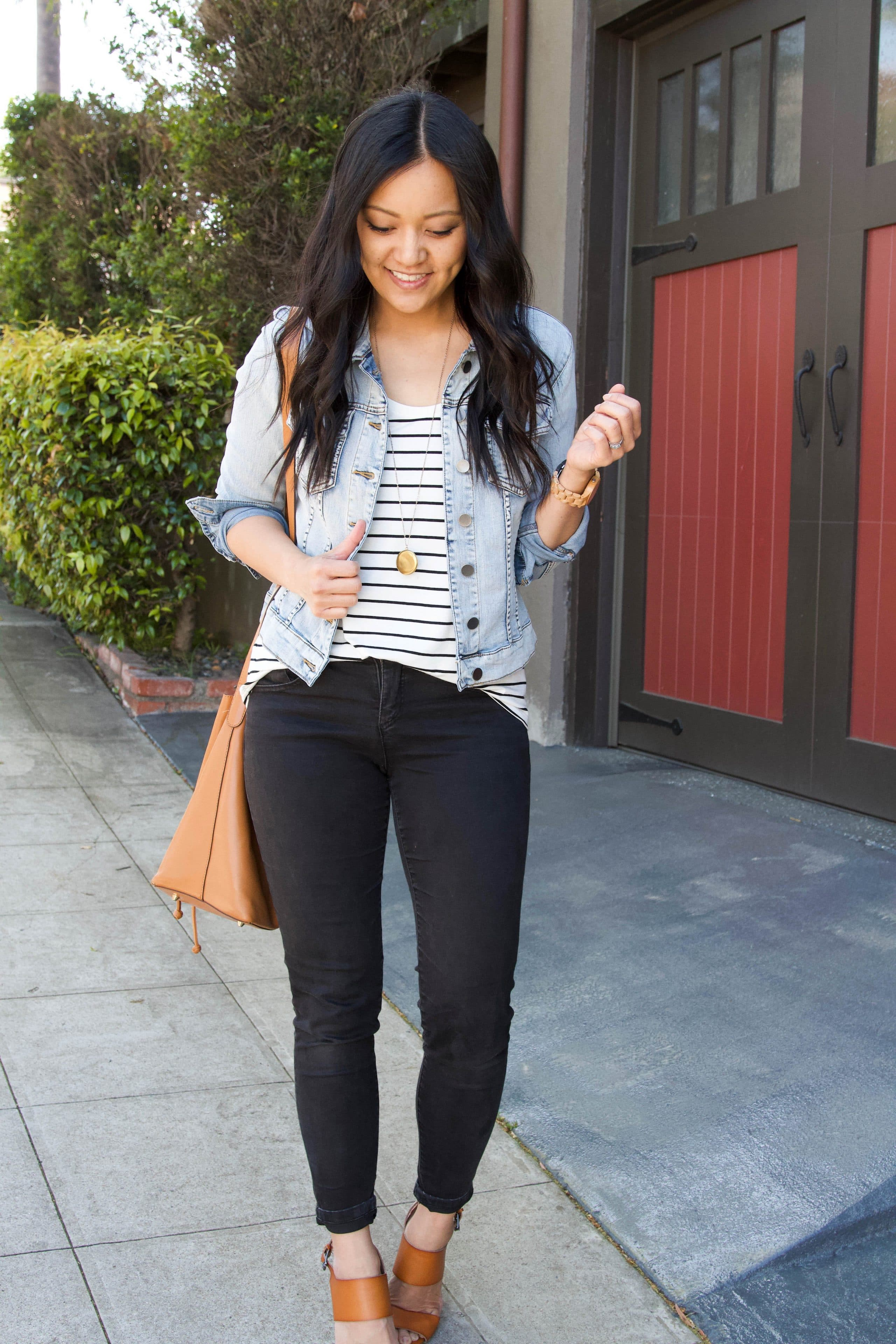 black jeans + black and white striped tee + denim jacket + tan wedges + tan purse