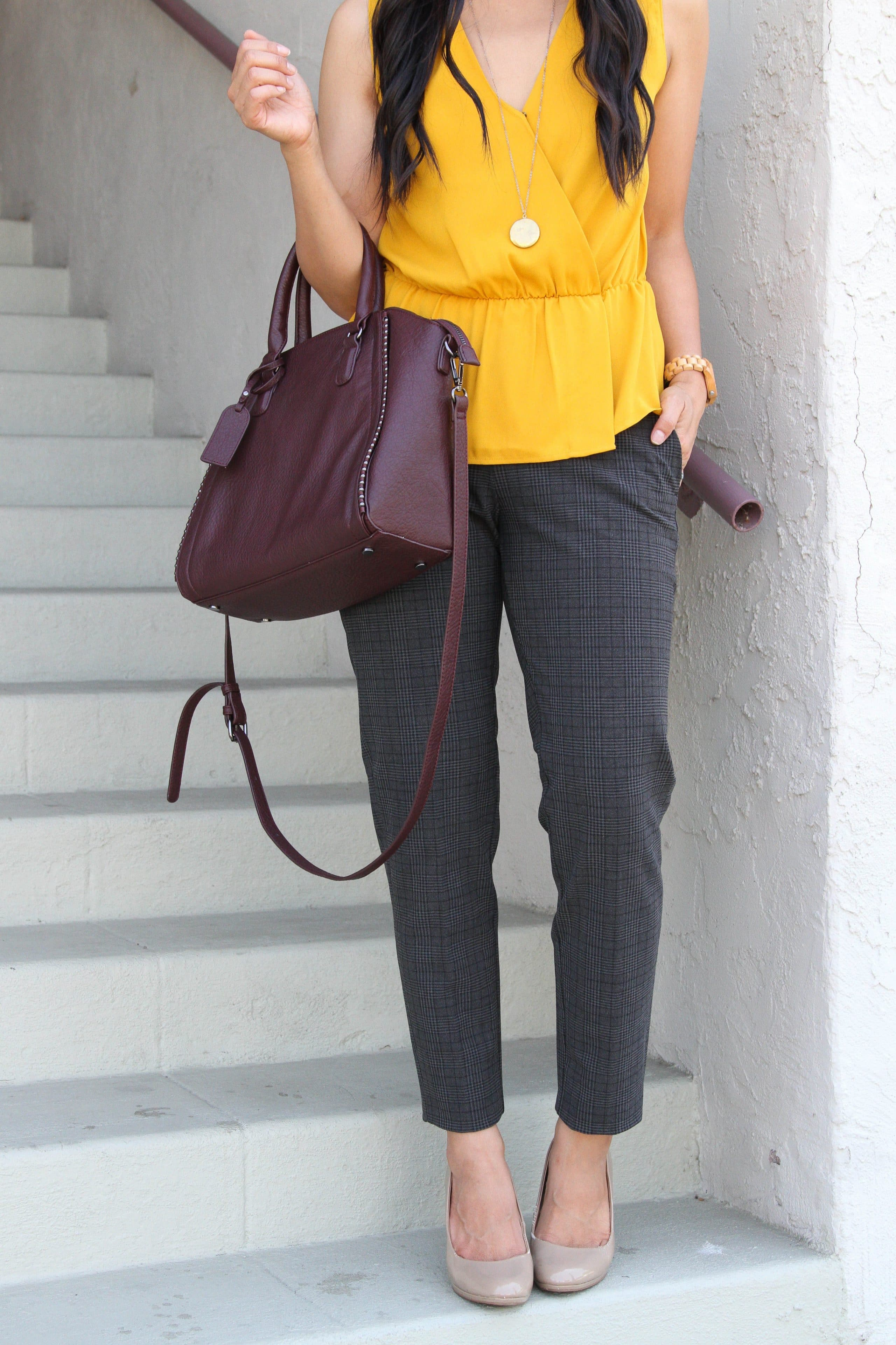 yellow top + taupe pants + grey pants + maroon purse + long pendant necklace