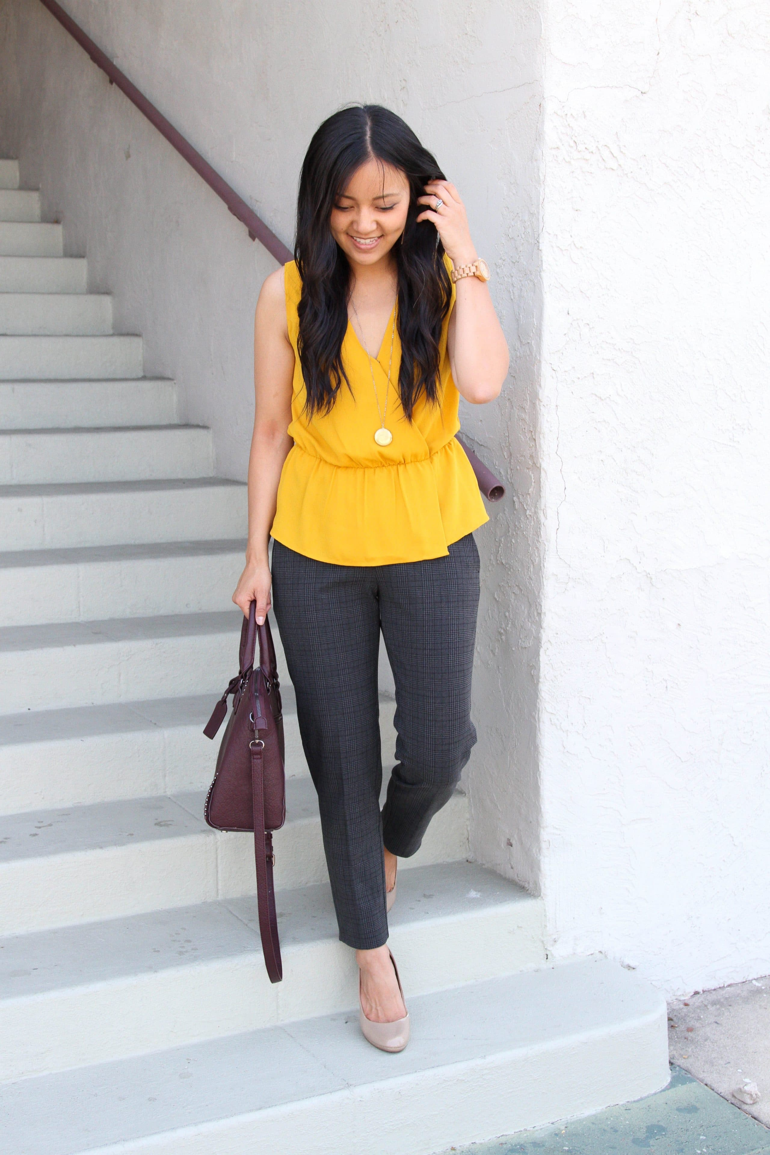 yellow top + grey pants + taupe pumps + maroon purse + long pendant necklace