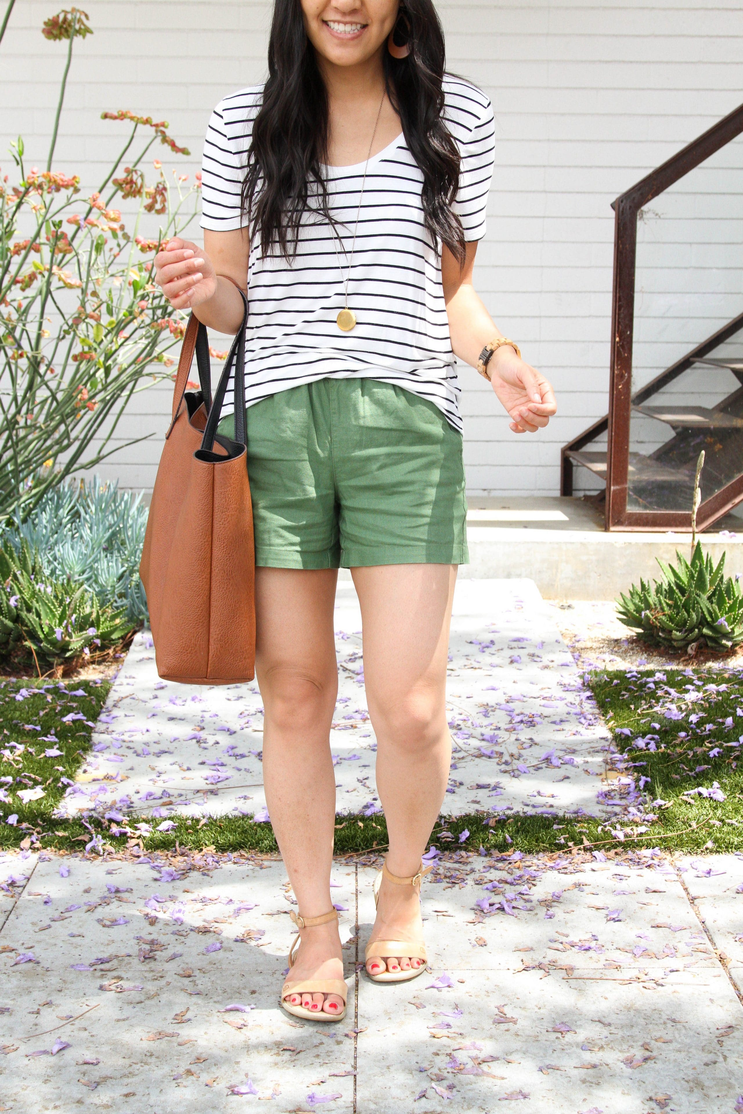 olive shorts + tan sandals + stripped tee + brown tote + long pendant necklace