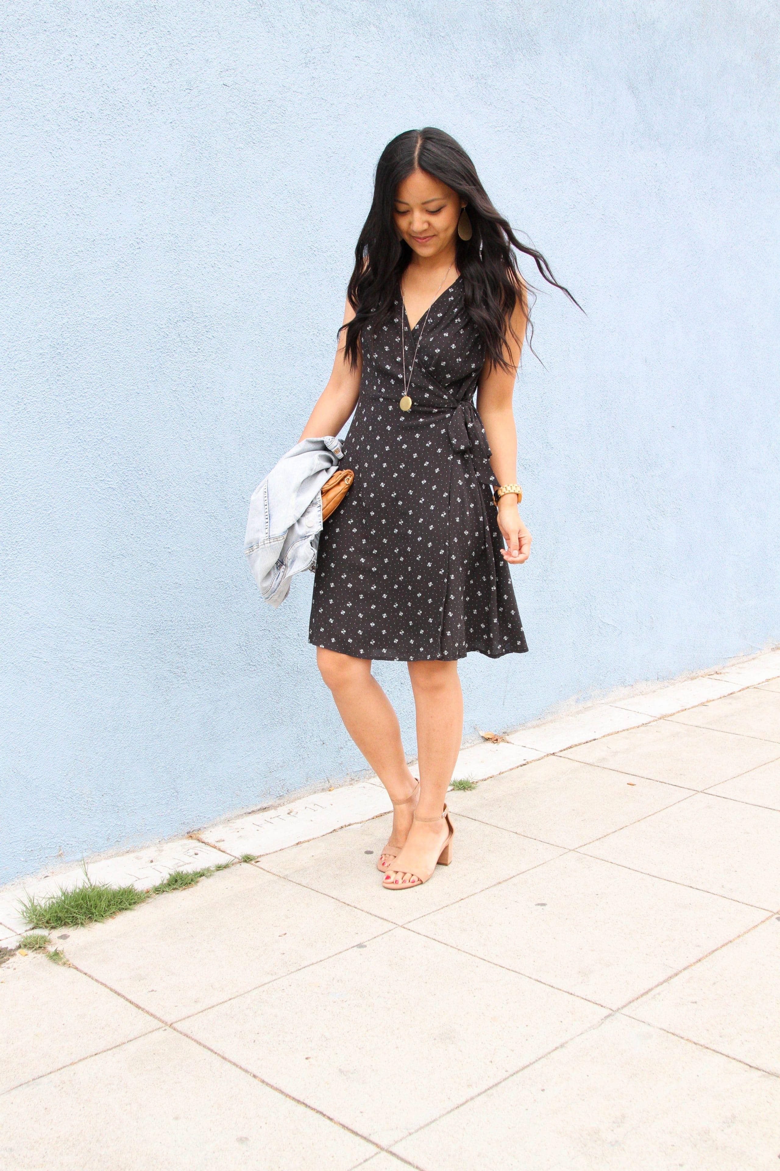 black floral wrap dress + pendant necklace + taupe block heel sandals + cognac clutch + denim jacket