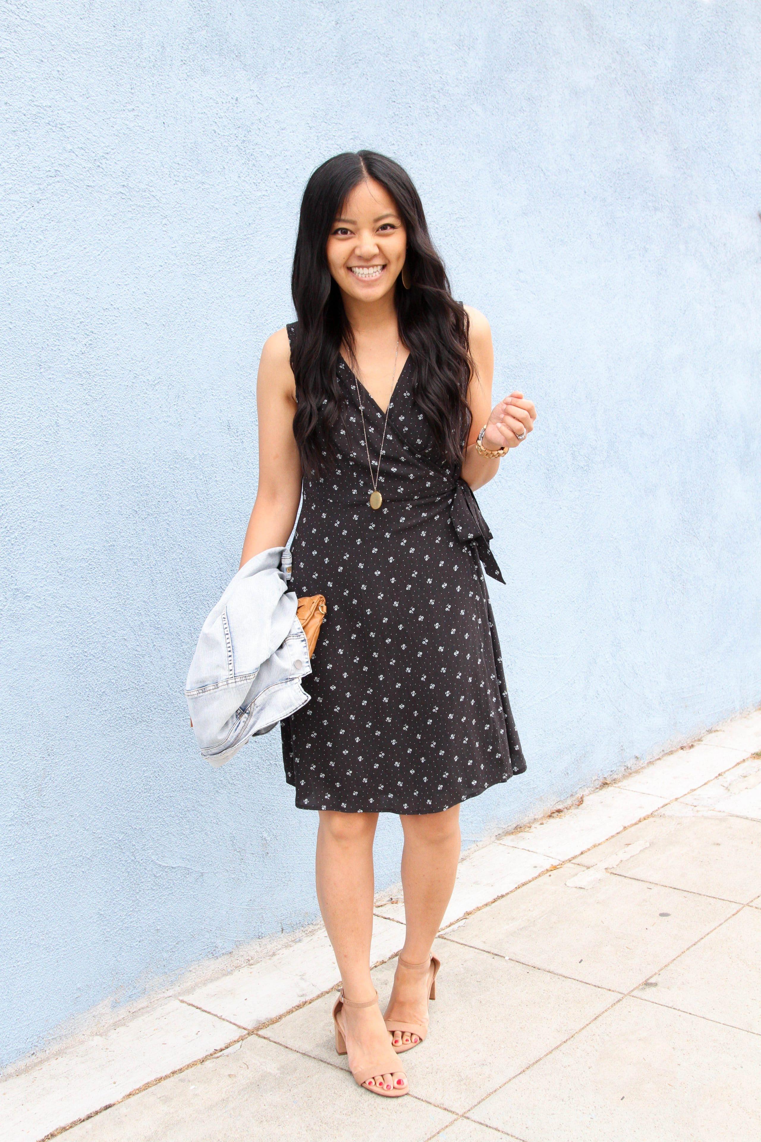 black floral wrap dress + taupe block heel sandals + pendant necklace + denim jacket + cognac clutch