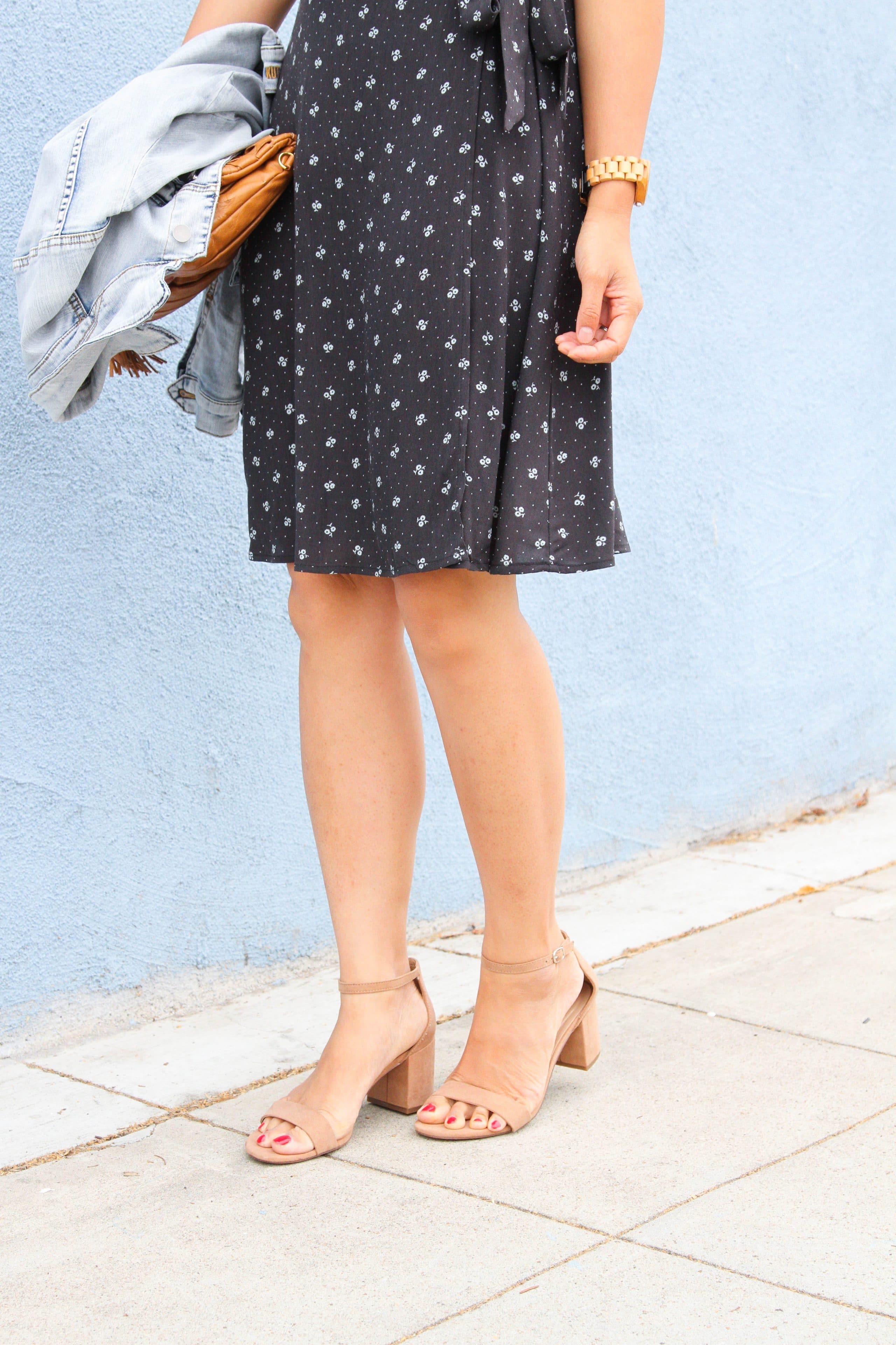 black floral wrap dress + taupe block heel sandals + denim jacket + cognac clutch