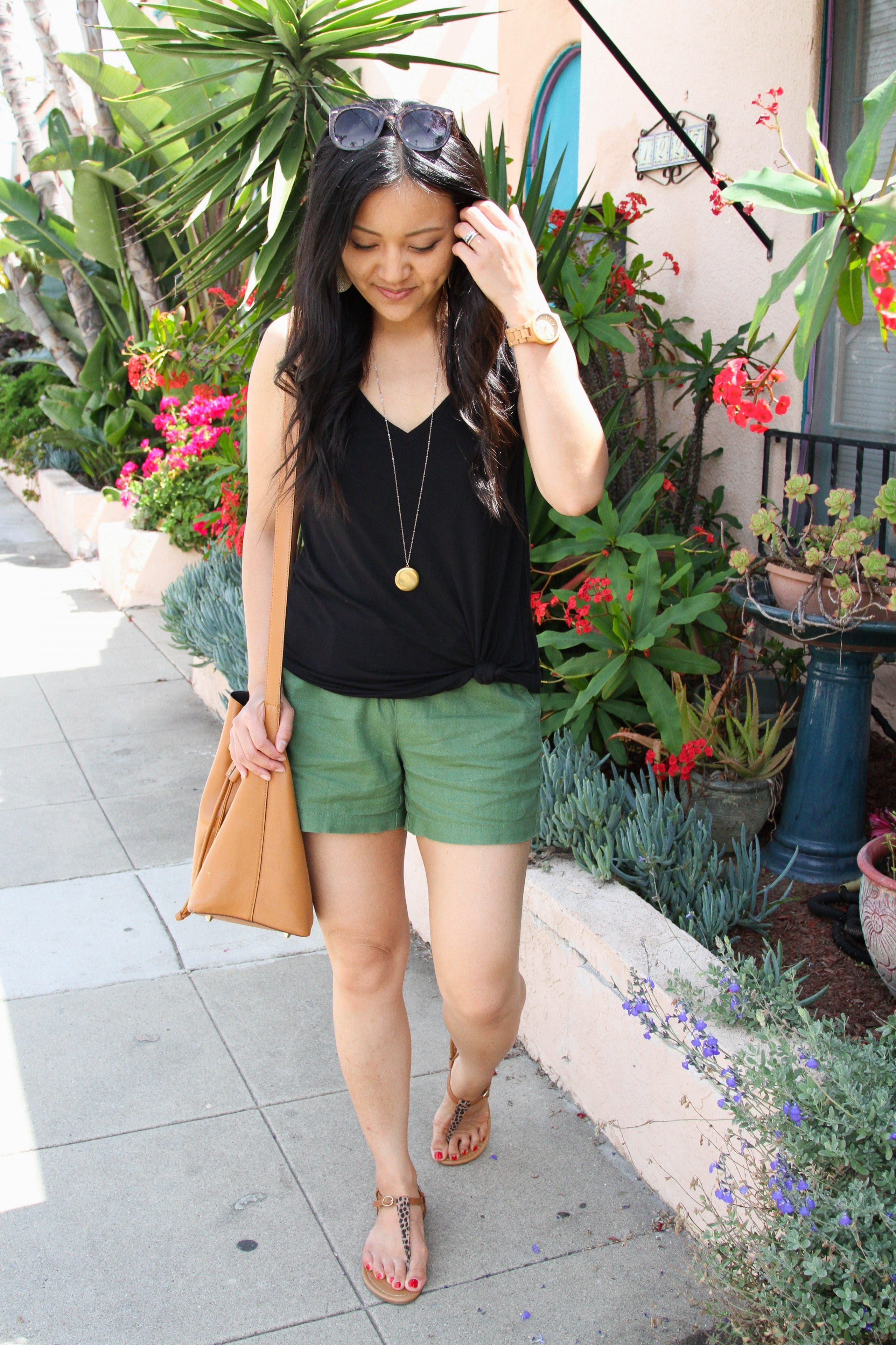 olive shorts + black tank top + long pendant necklace + brown tote + leopard print sandals