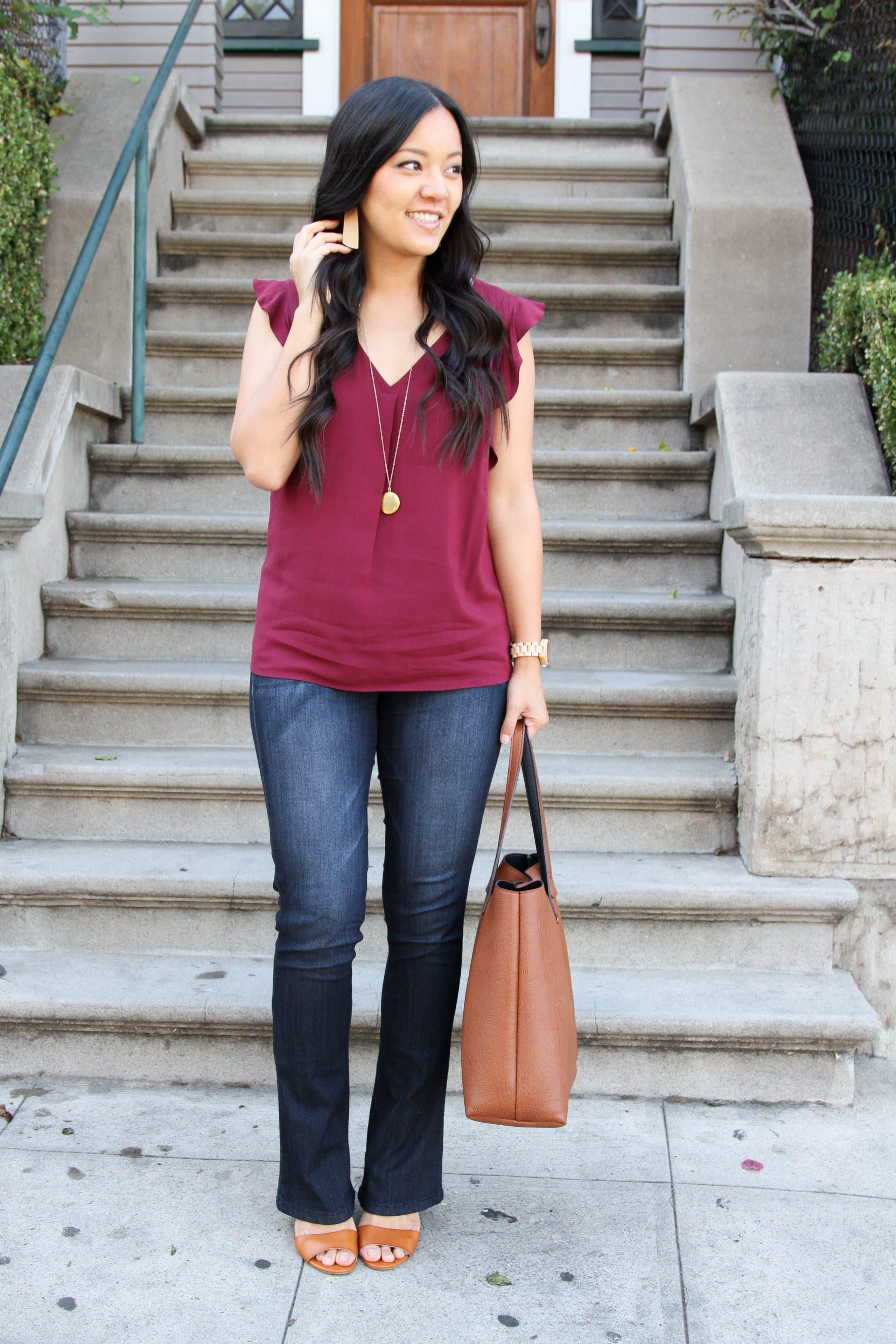 maroon top + bootcut jeans + wedges + cognac tote