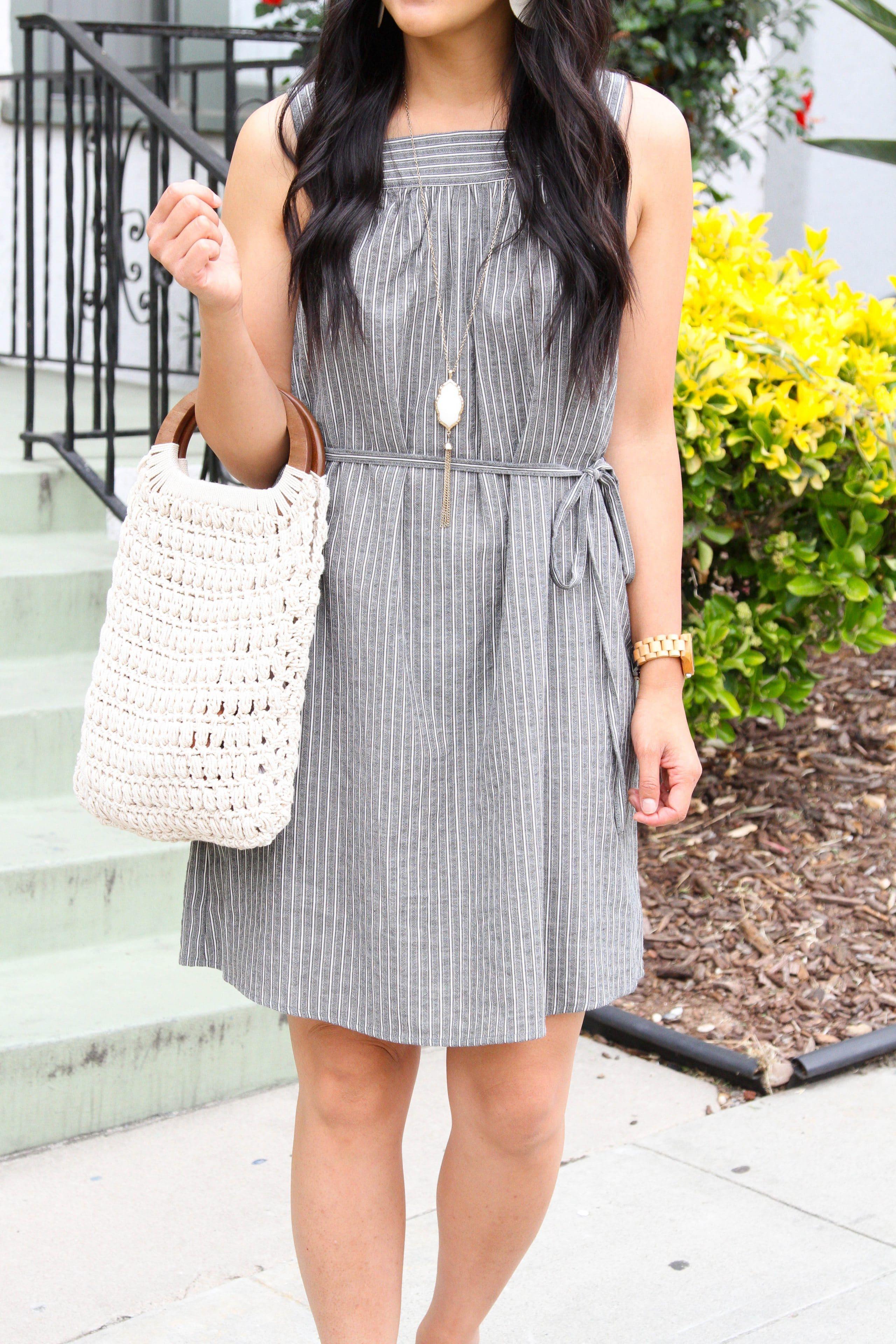 grey and white striped dress + long pendant necklace + white macrame handbag