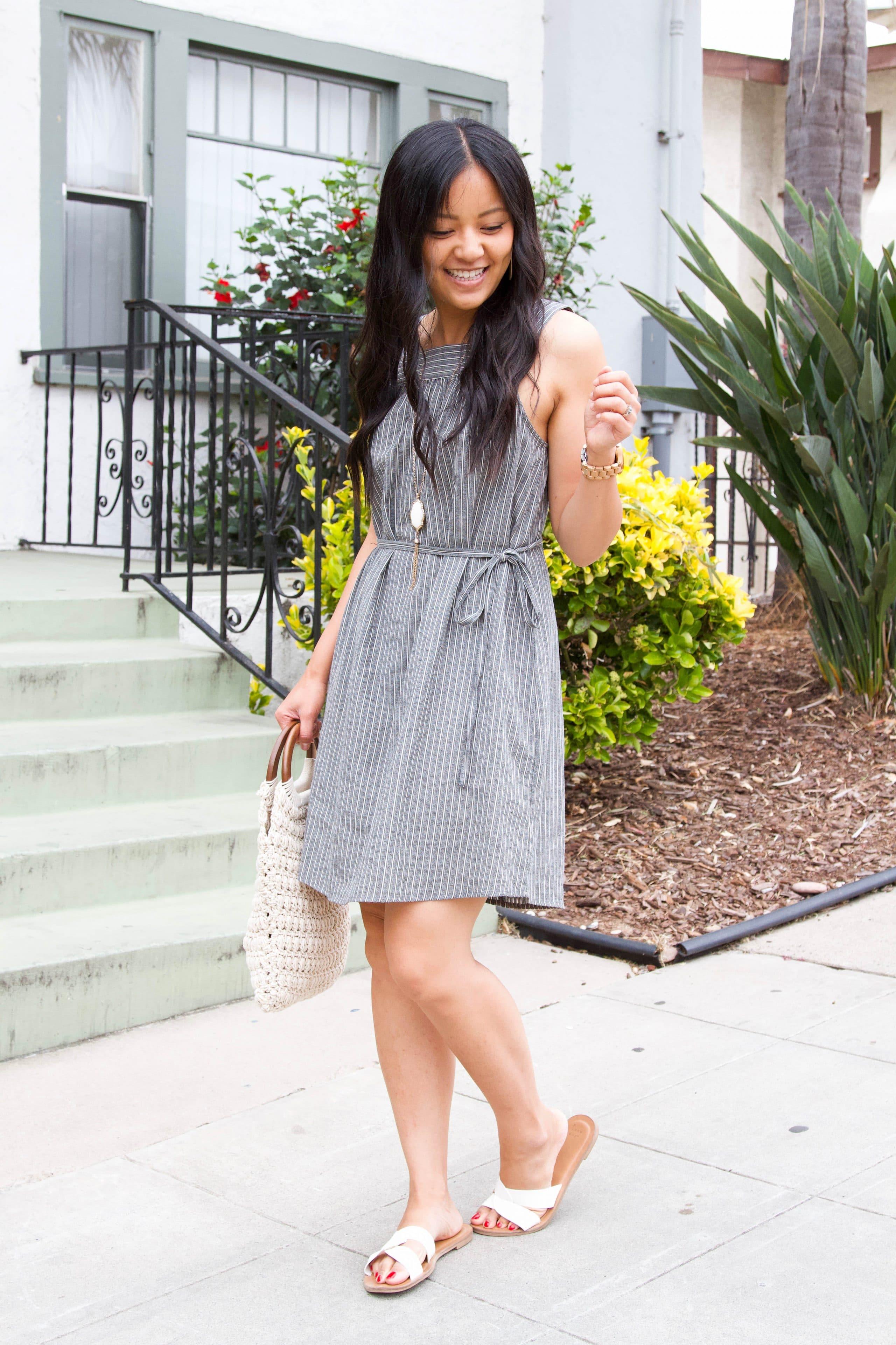grey and white striped dress + long pendant necklace + white macrame handbag + white sandals