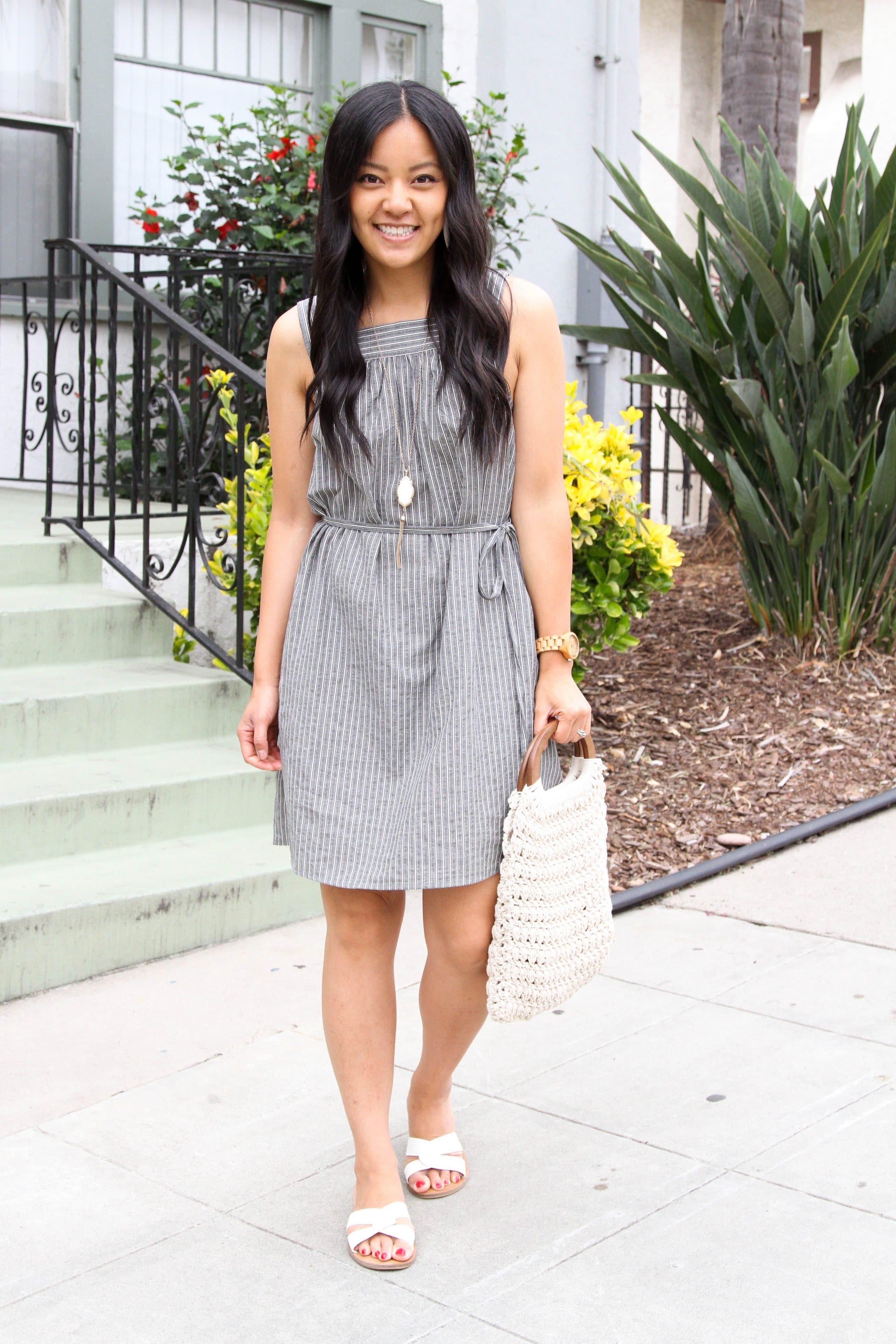 grey and white striped dress + white sandals + long pendant necklace + white macrame handbag