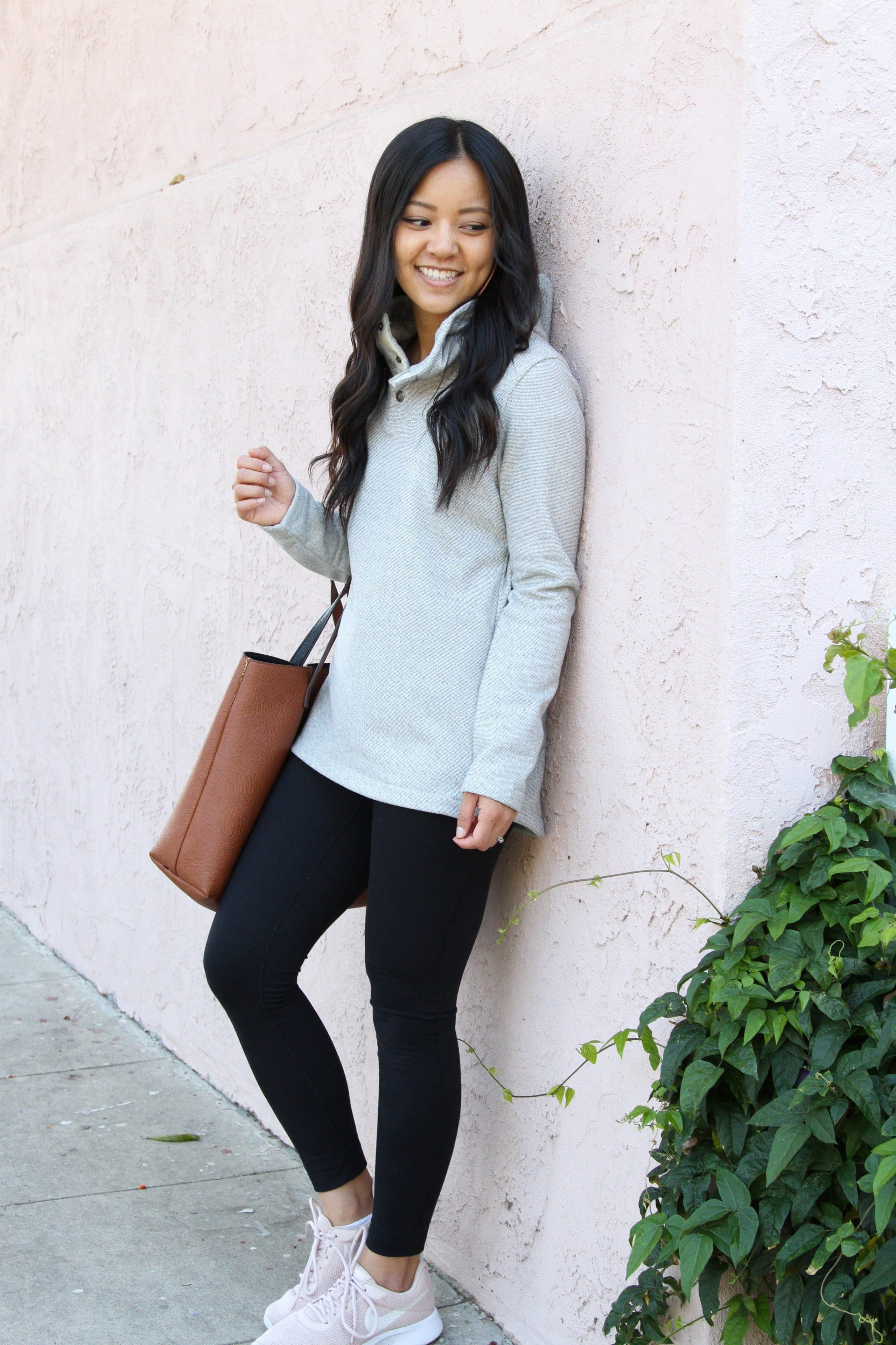 black leggings + pink sneakers + grey fleece + brown tote