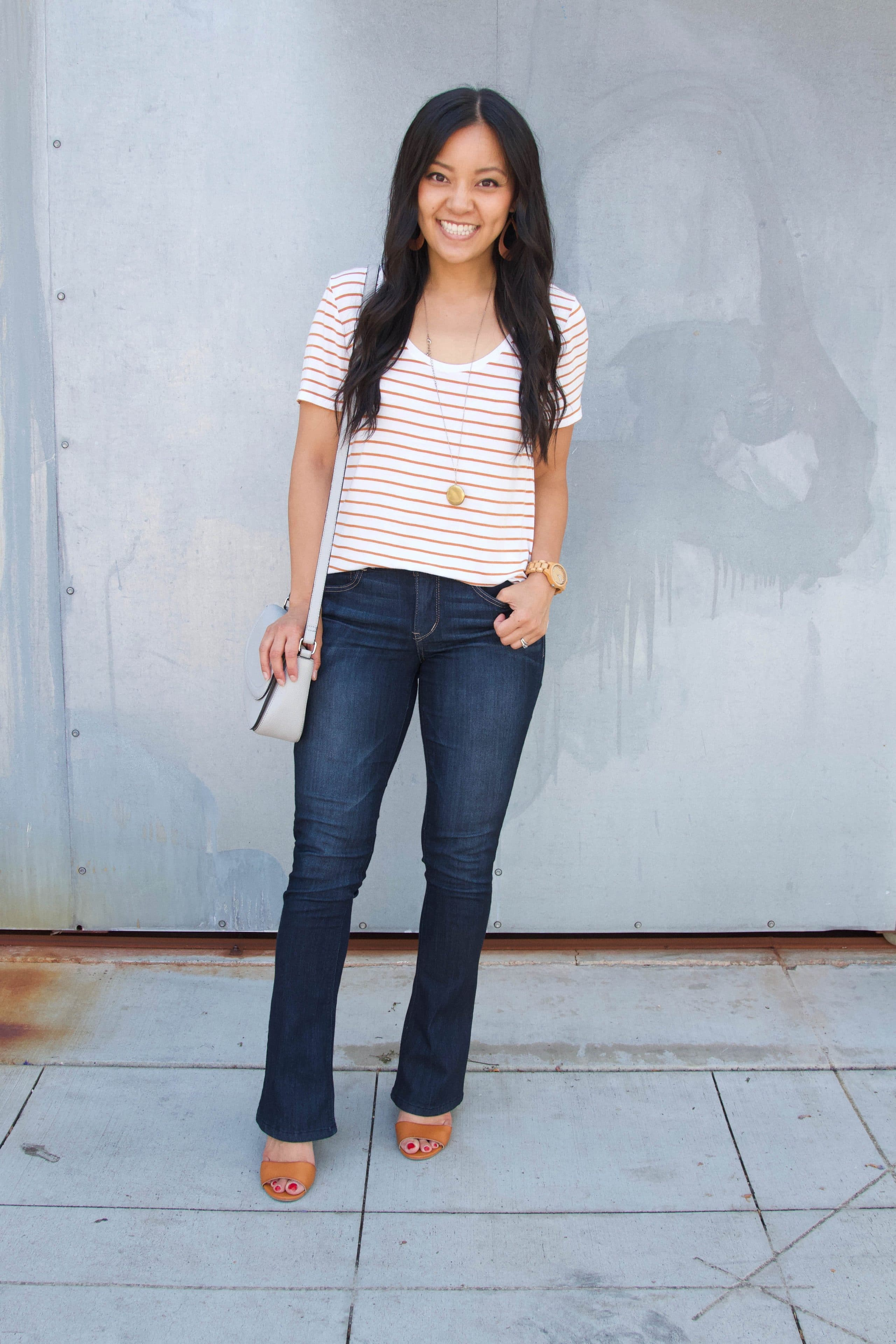 white and tan striped tee + bootcut jeans + long pendant necklace + taupe heels