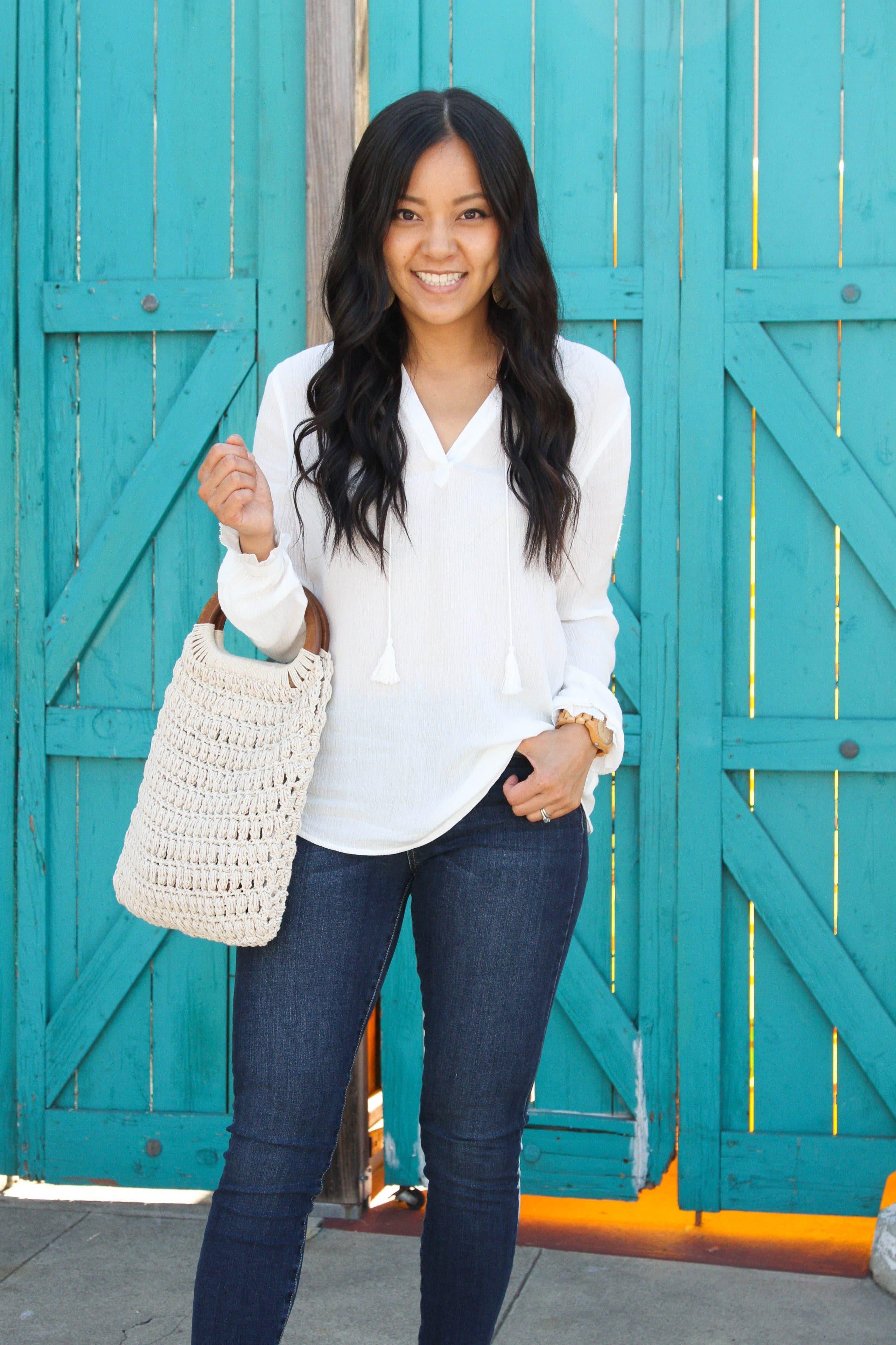 white blouse + white macrame handbag + jeans