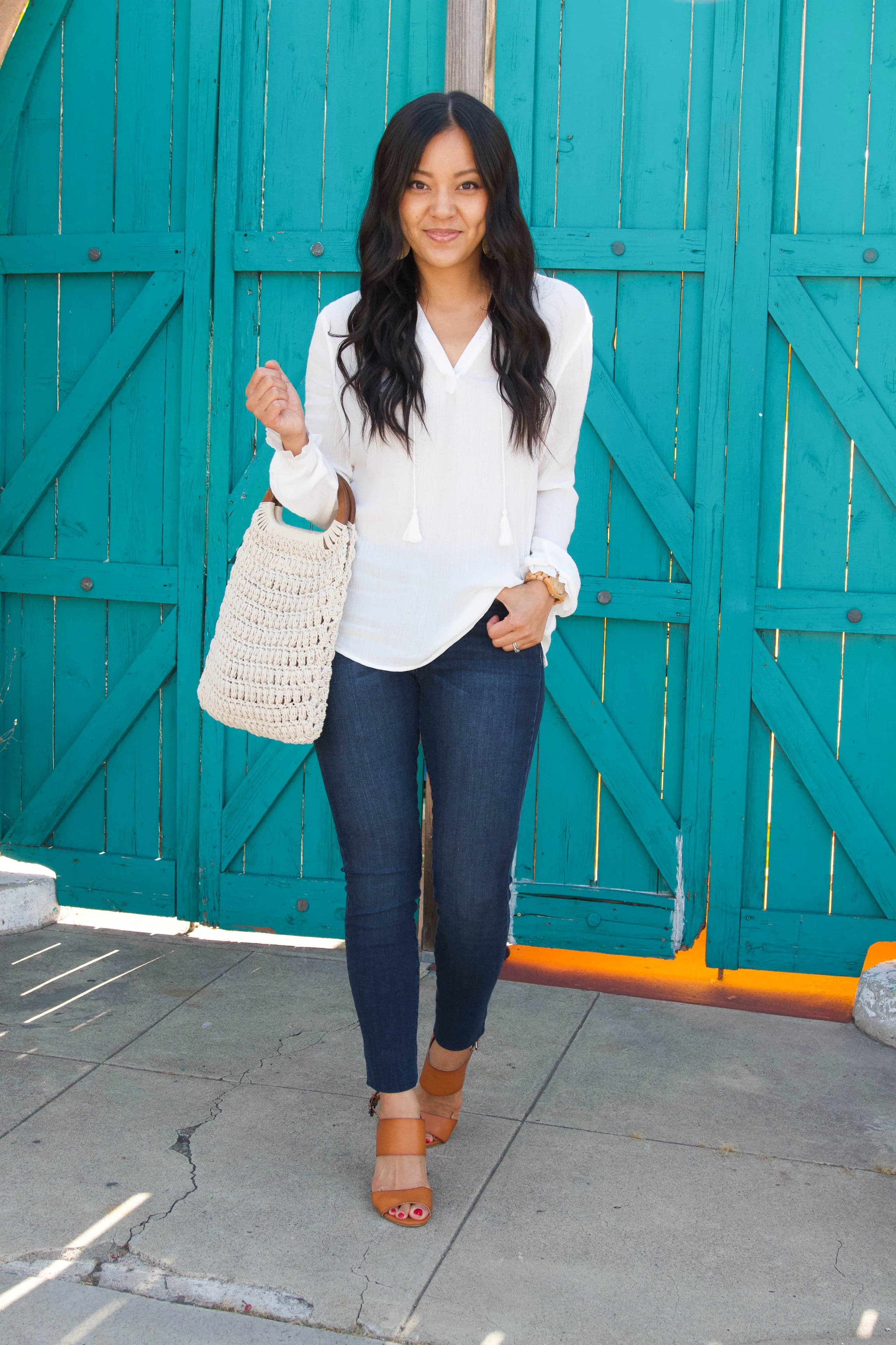 white blouse + jeans + cognac heels + white macrame bag