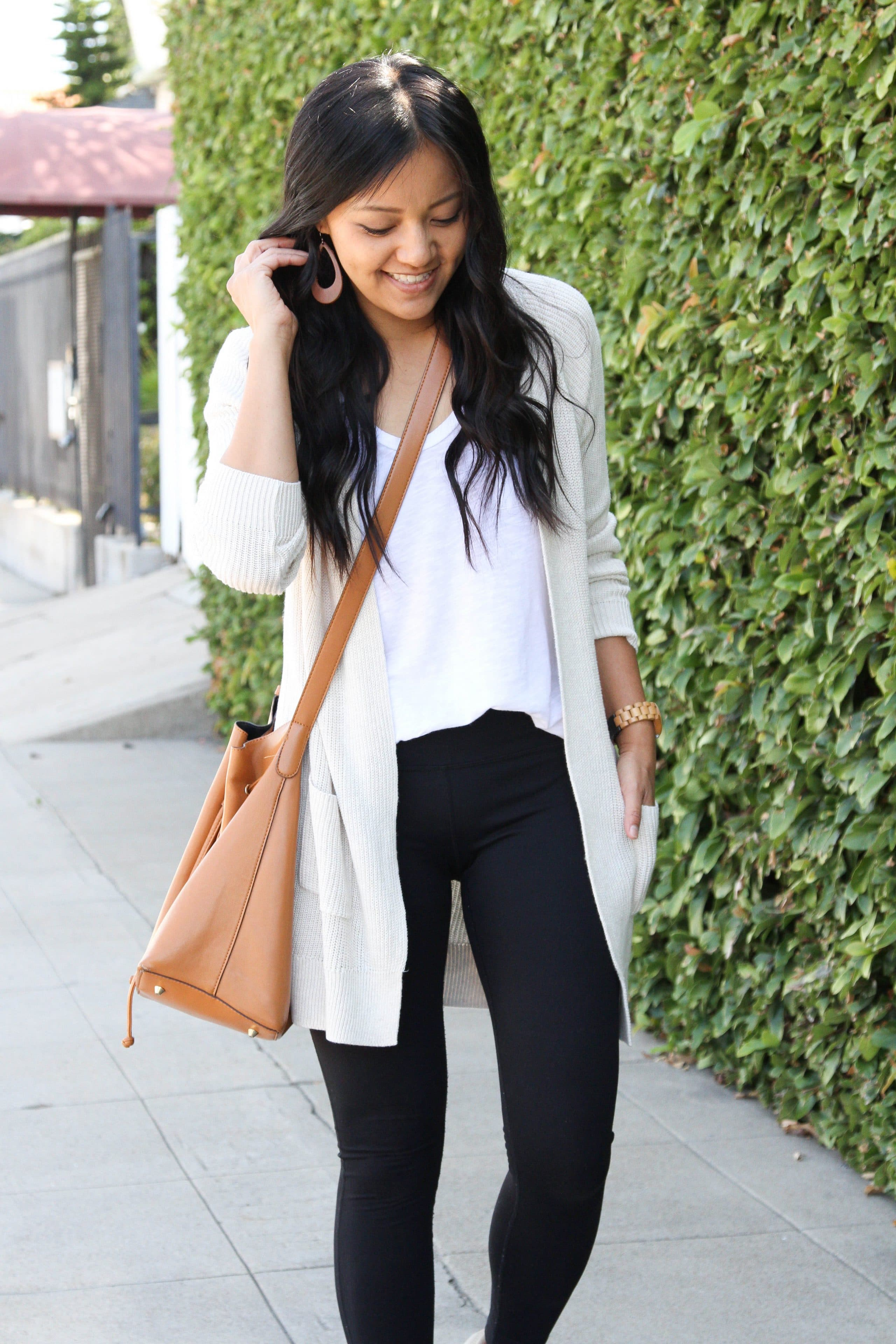 black leggings + white tee + cream cardigan + taupe sneakers + brown crossbody bag
