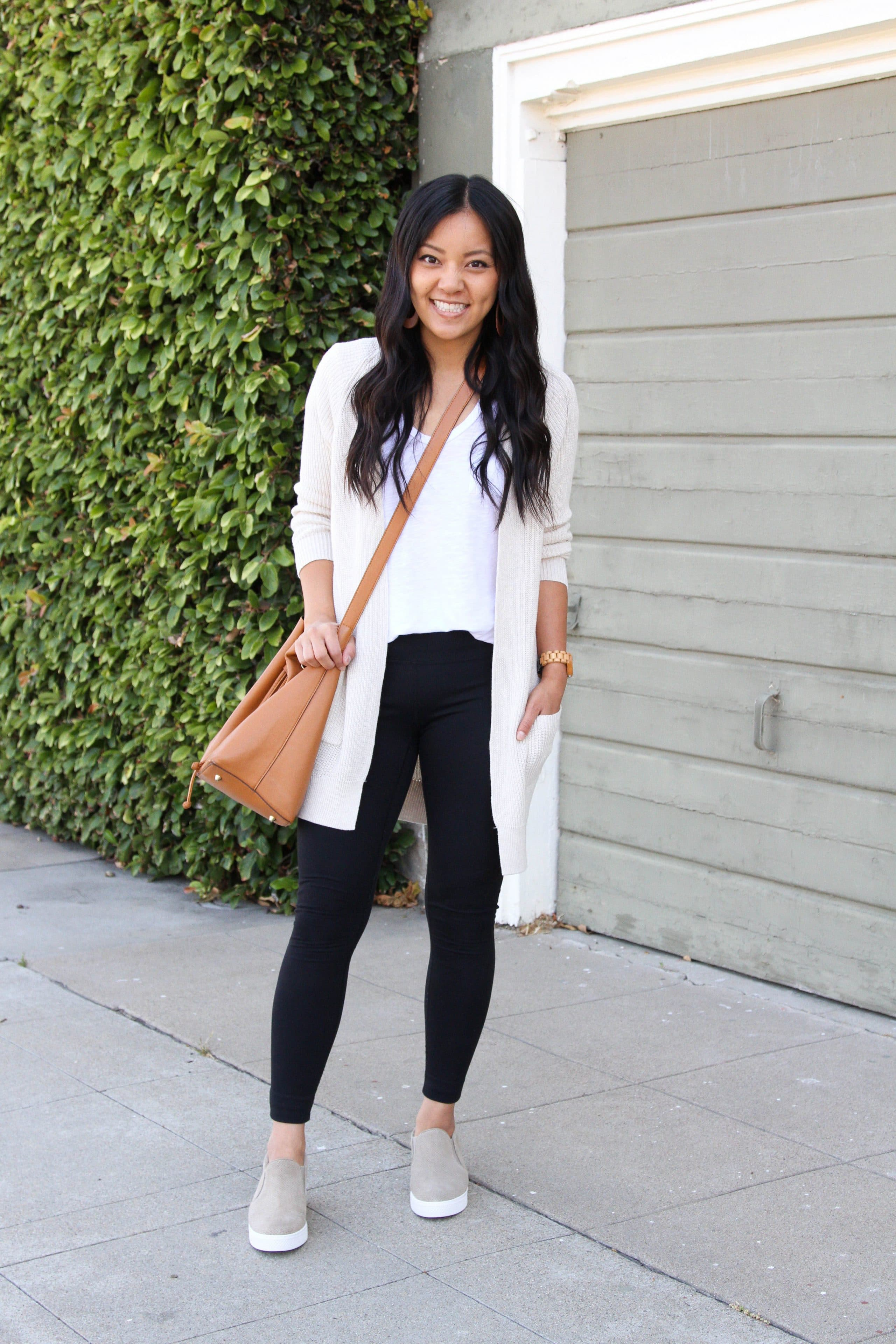 white tee + black leggings + cream cardigan + taupe sneakers + brown crossbody bag