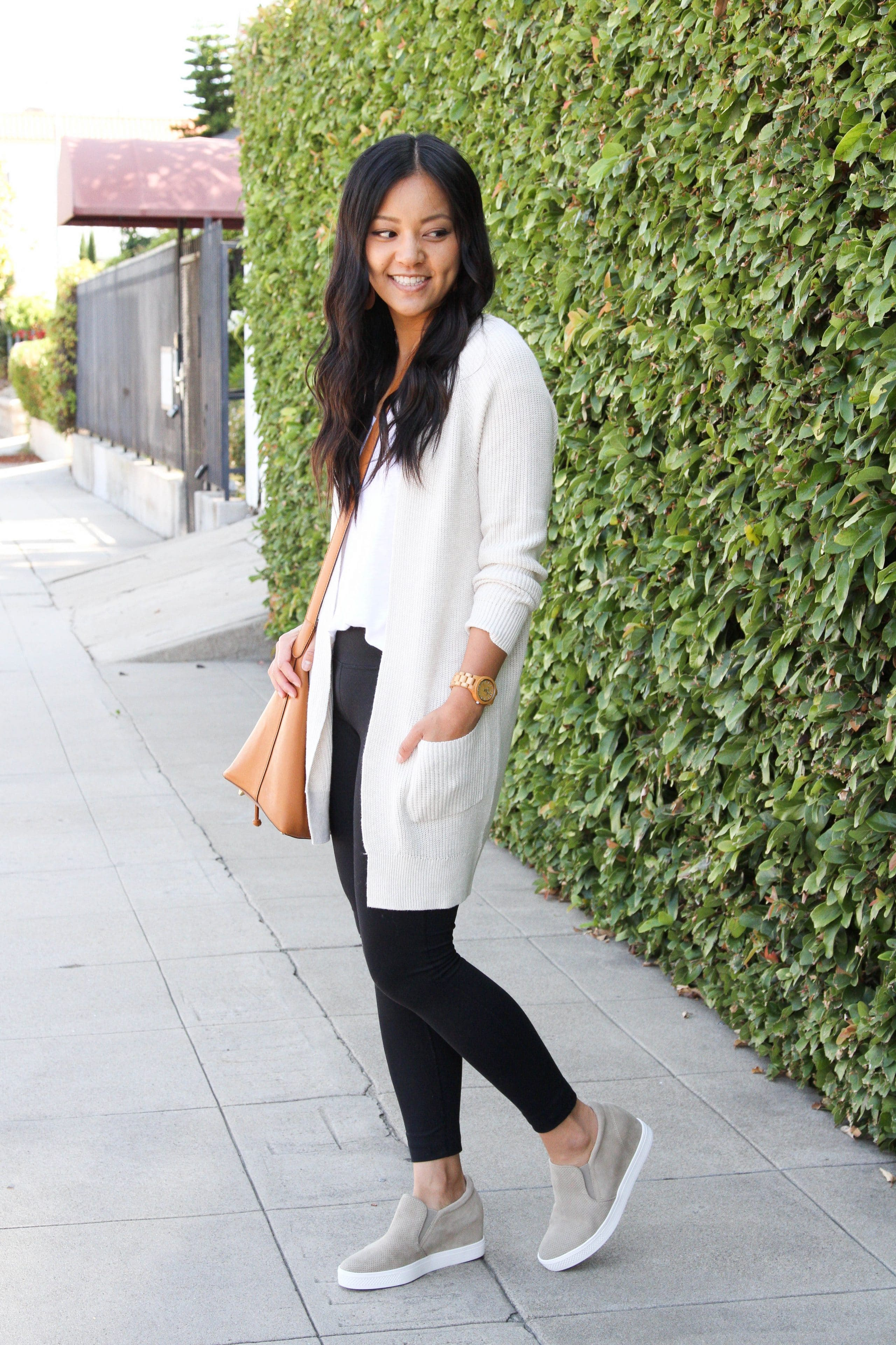 cream cardigan + white tee + black leggings + taupe sneakers