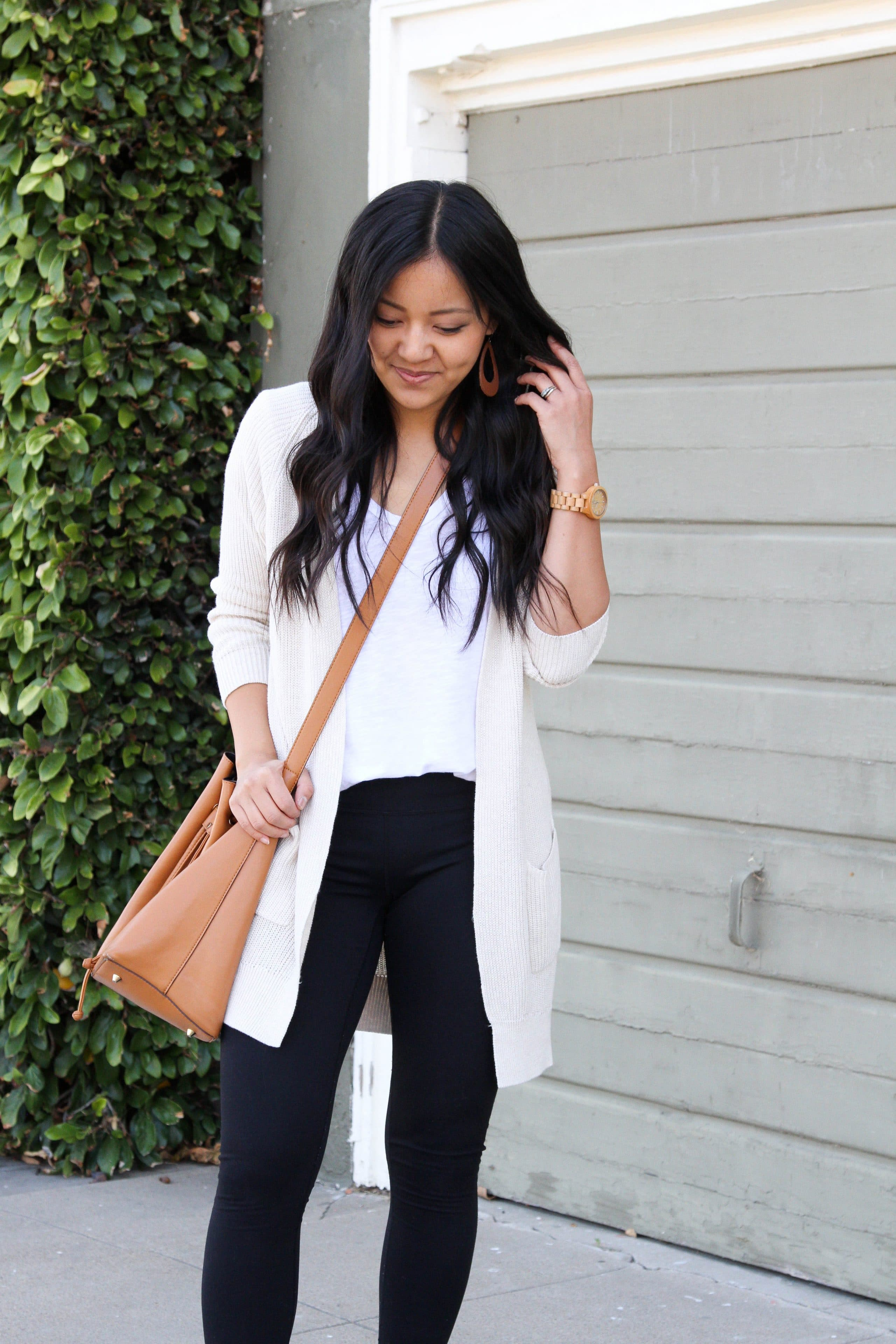 cream cardigan + black leggings + white tee + earrings + brown crossbody bag