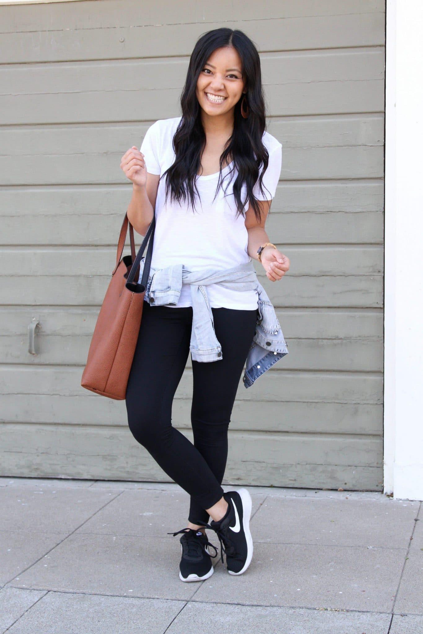 Casual Athleisure Outfit: white tee + black leggings + denim jacket + black sneakers + cognac tote + tan leather earrings