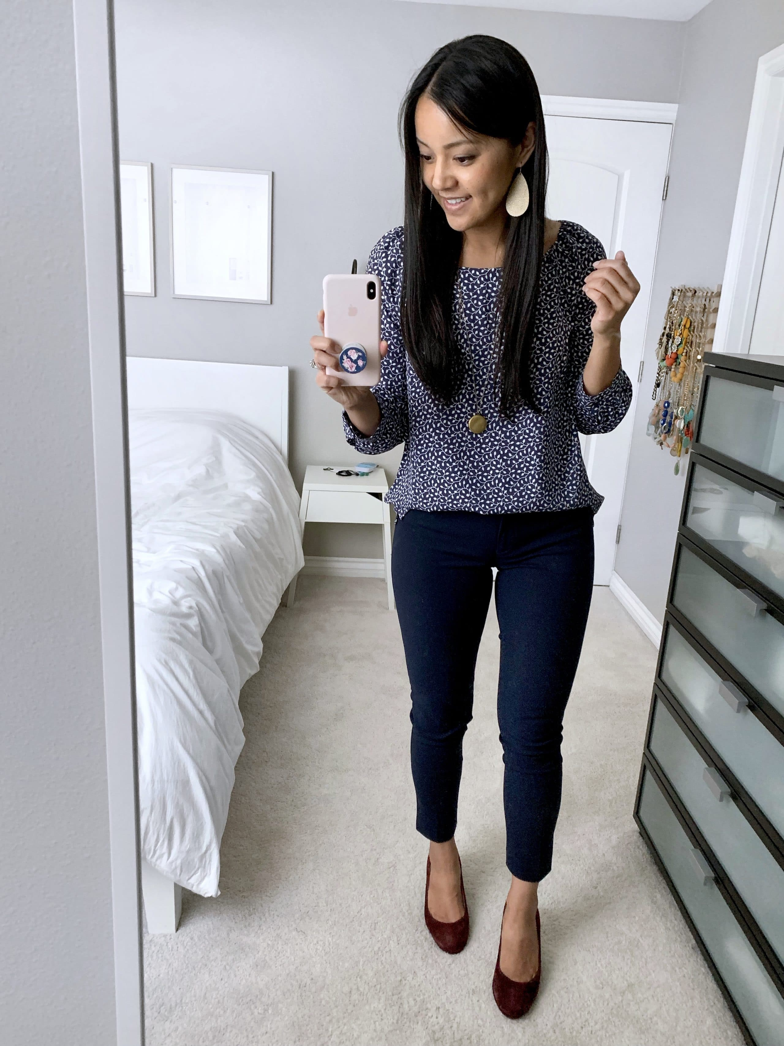 Business Casual Outfit: navy pants + blue printed top + maroon heels
