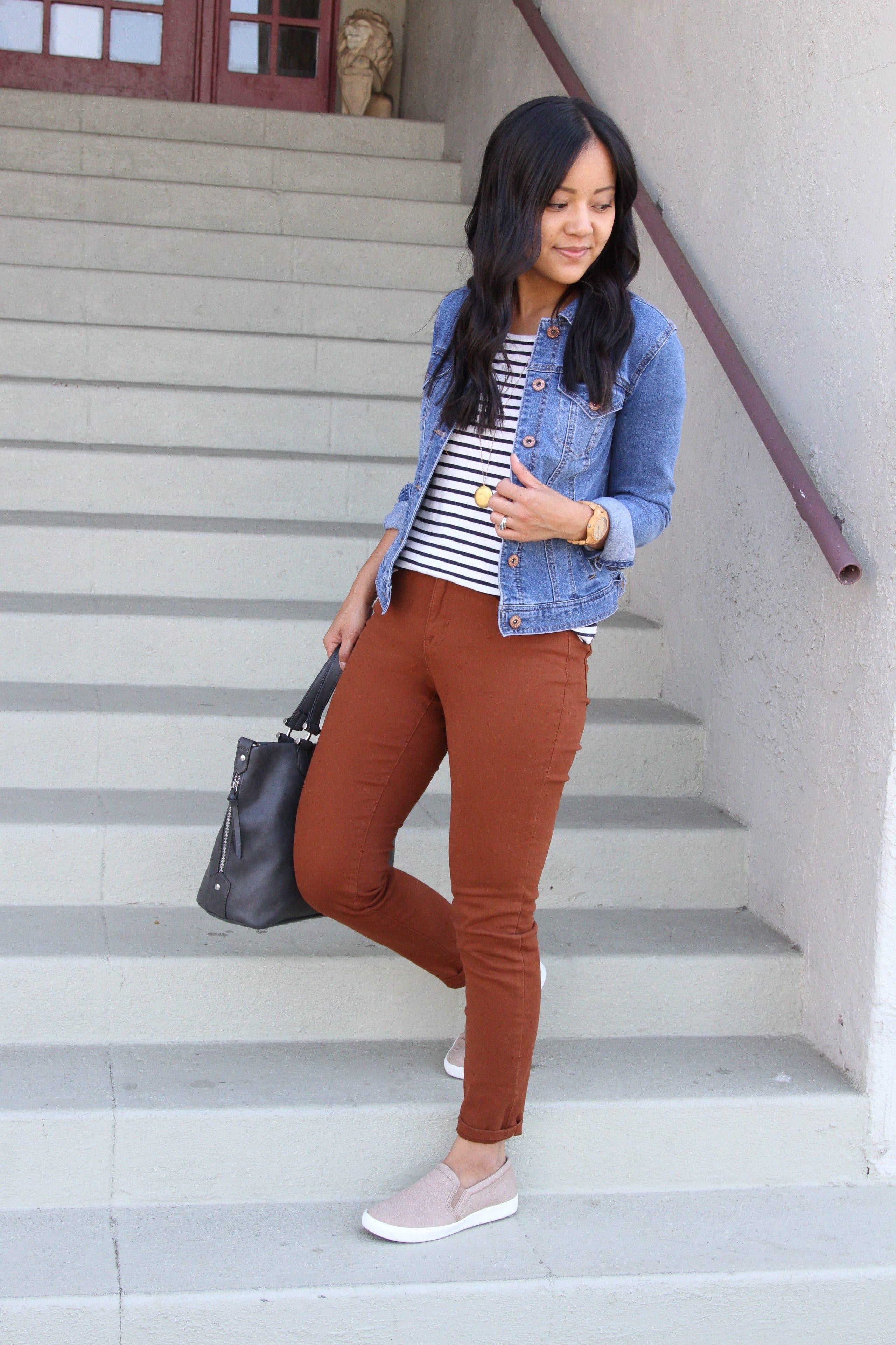 black and white striped tee + brown skinnies + denim jacket + tan slip on sneakers + grey purse