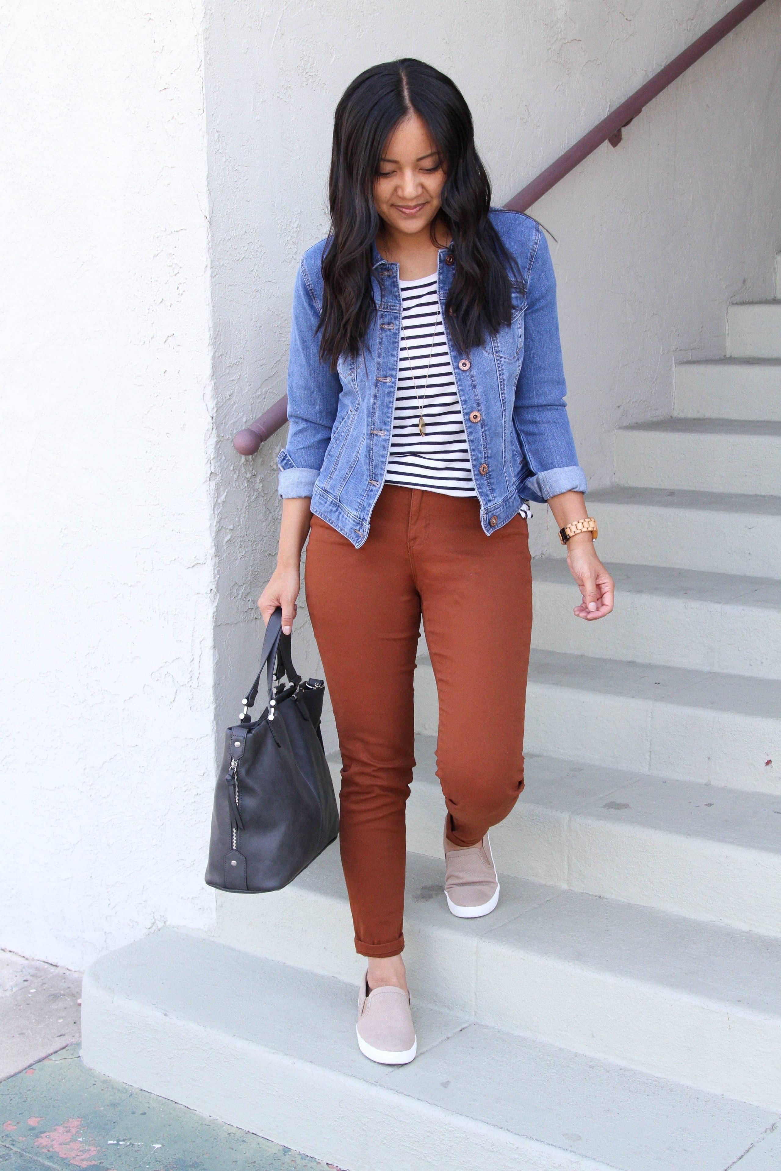 black and white striped tee + brown skinnies + denim jacket + grey purse + tan slip on sneakers