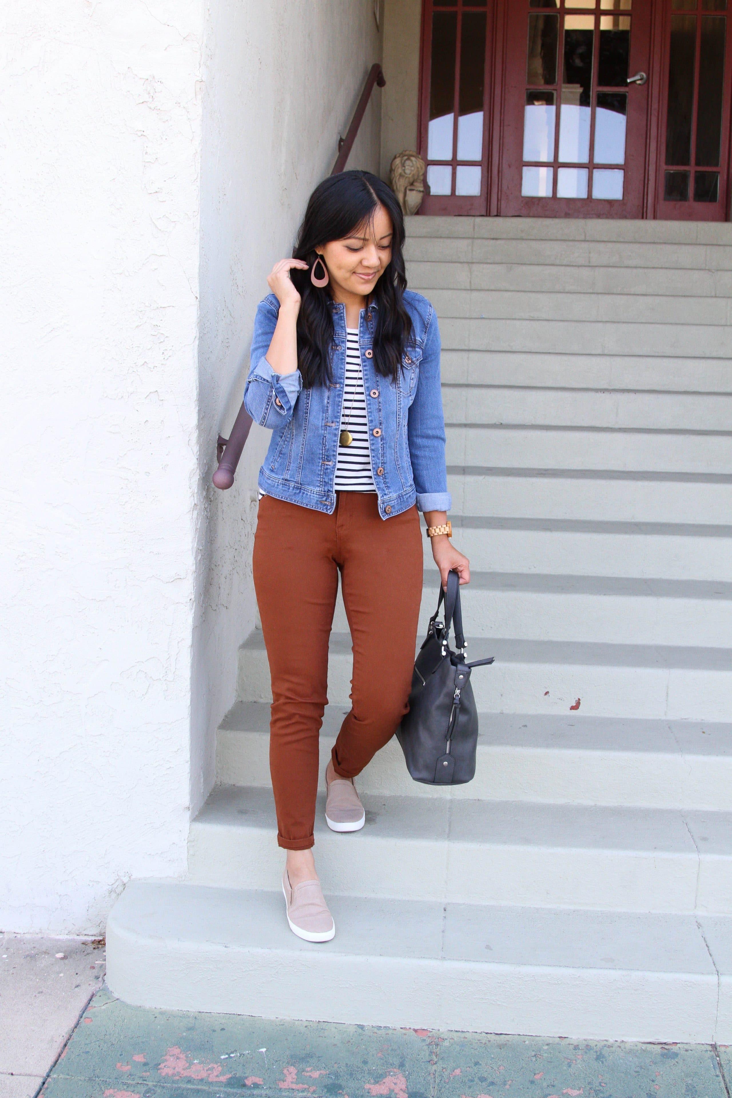 black and white striped tee + brown skinnies + tan slip on sneakers + denim jacket + grey purse