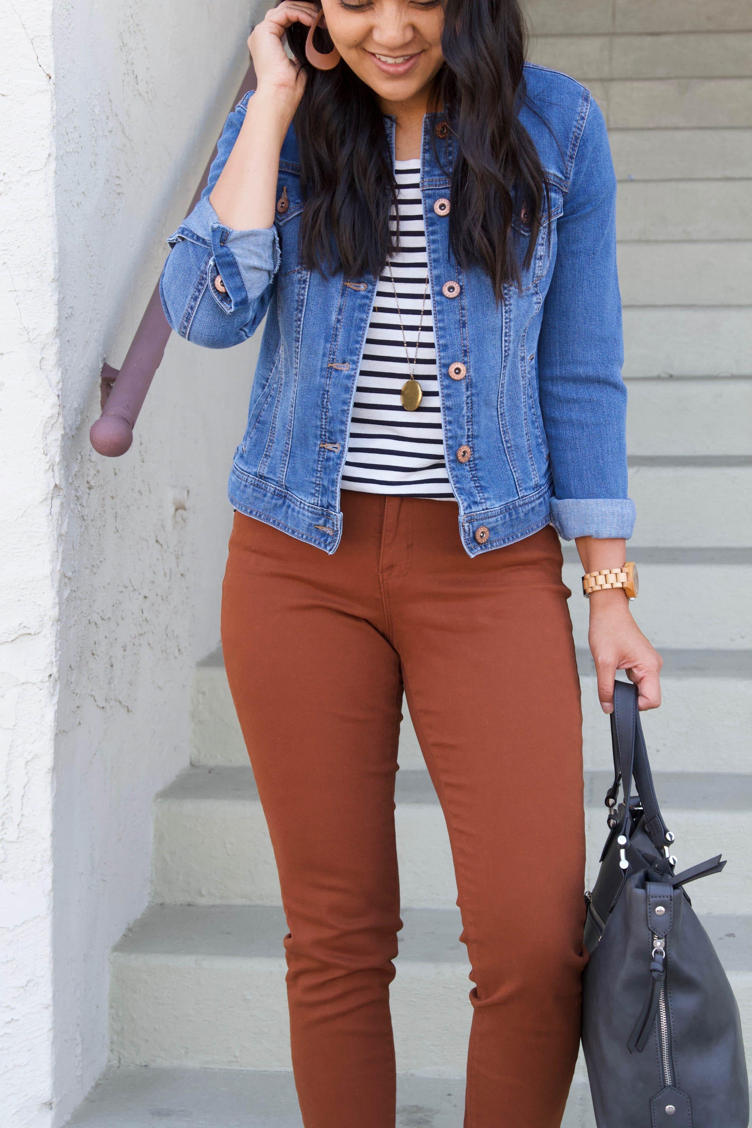 black and white striped tee + denim jacket + brown skinnies + tan slip on sneakers + grey purse