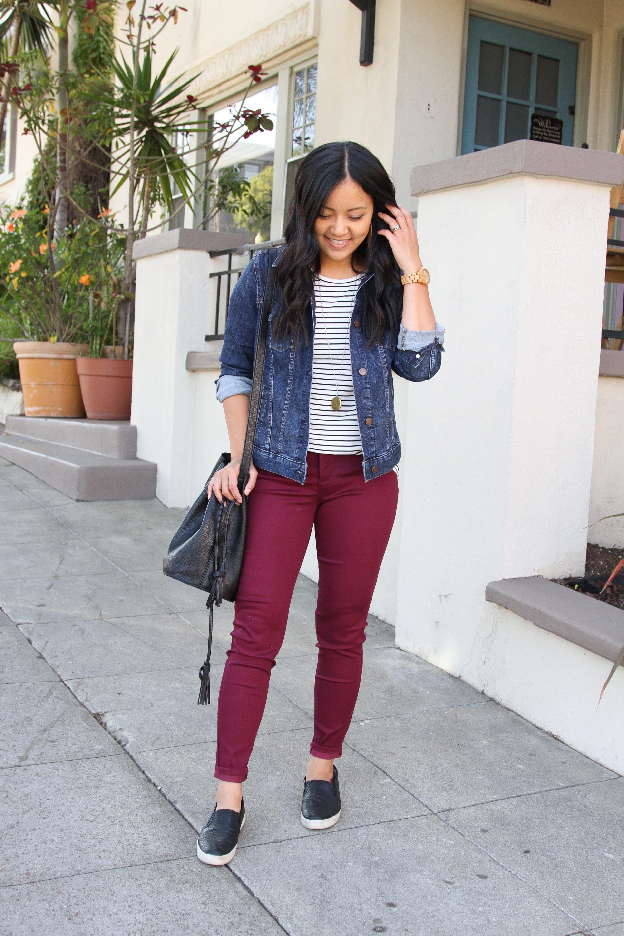 black and white striped tee + denim jacket + maroon pants + black slip on shoes + black purse