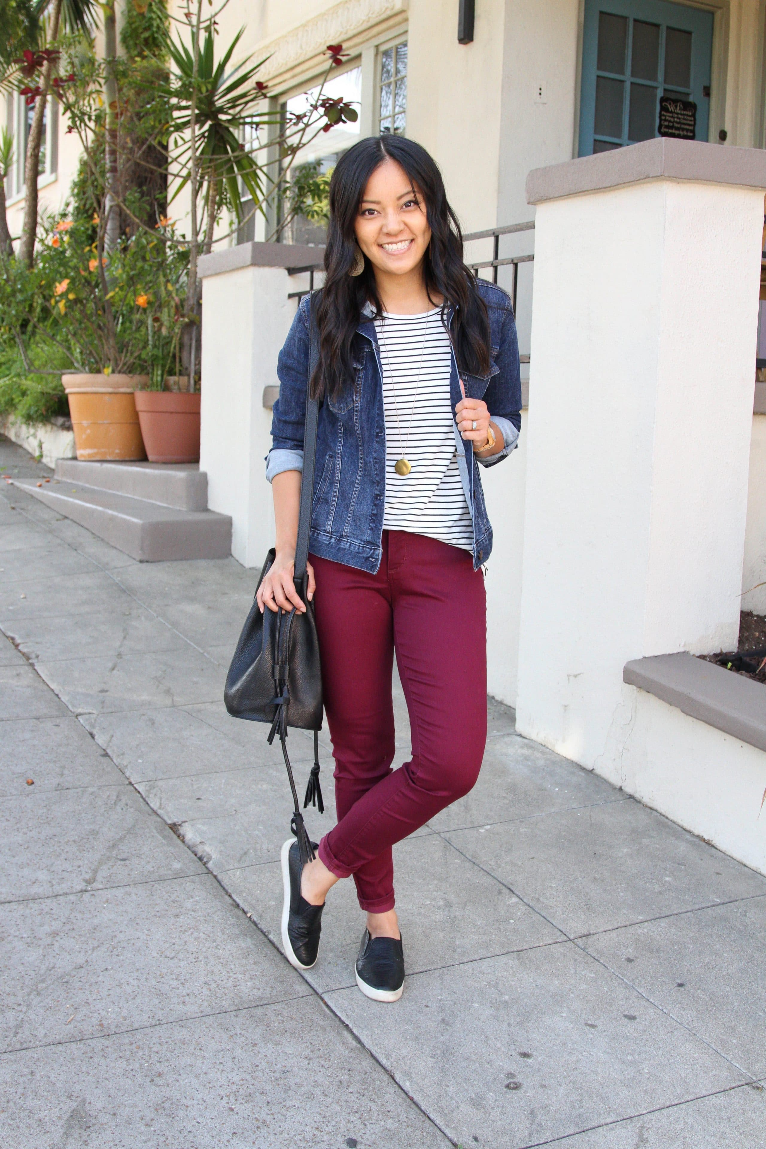 denim jacket + black and white striped tee + maroon pants + black slip on shoes + black purse