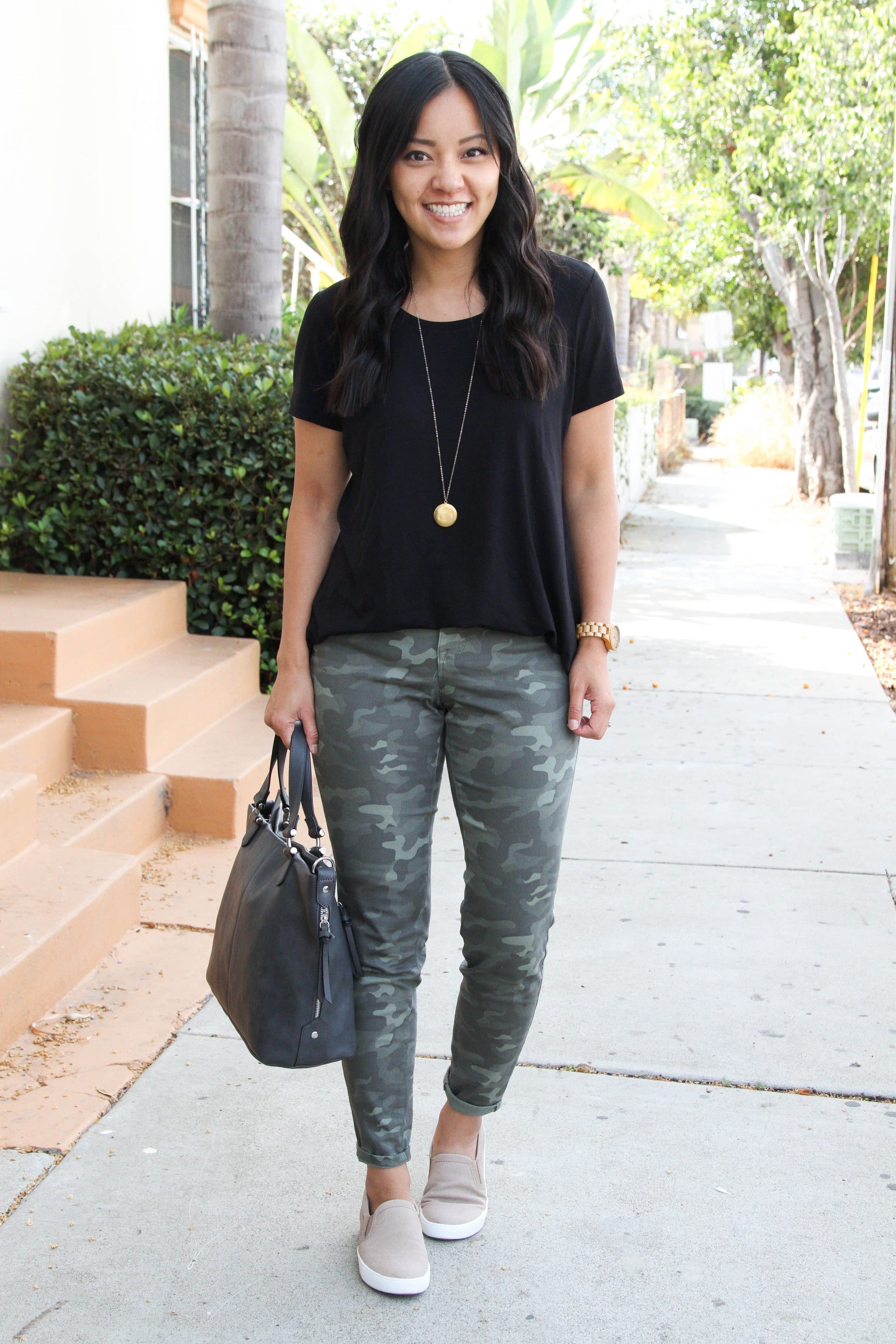 taupe sneakers + black top + green camo pants + grey tote
