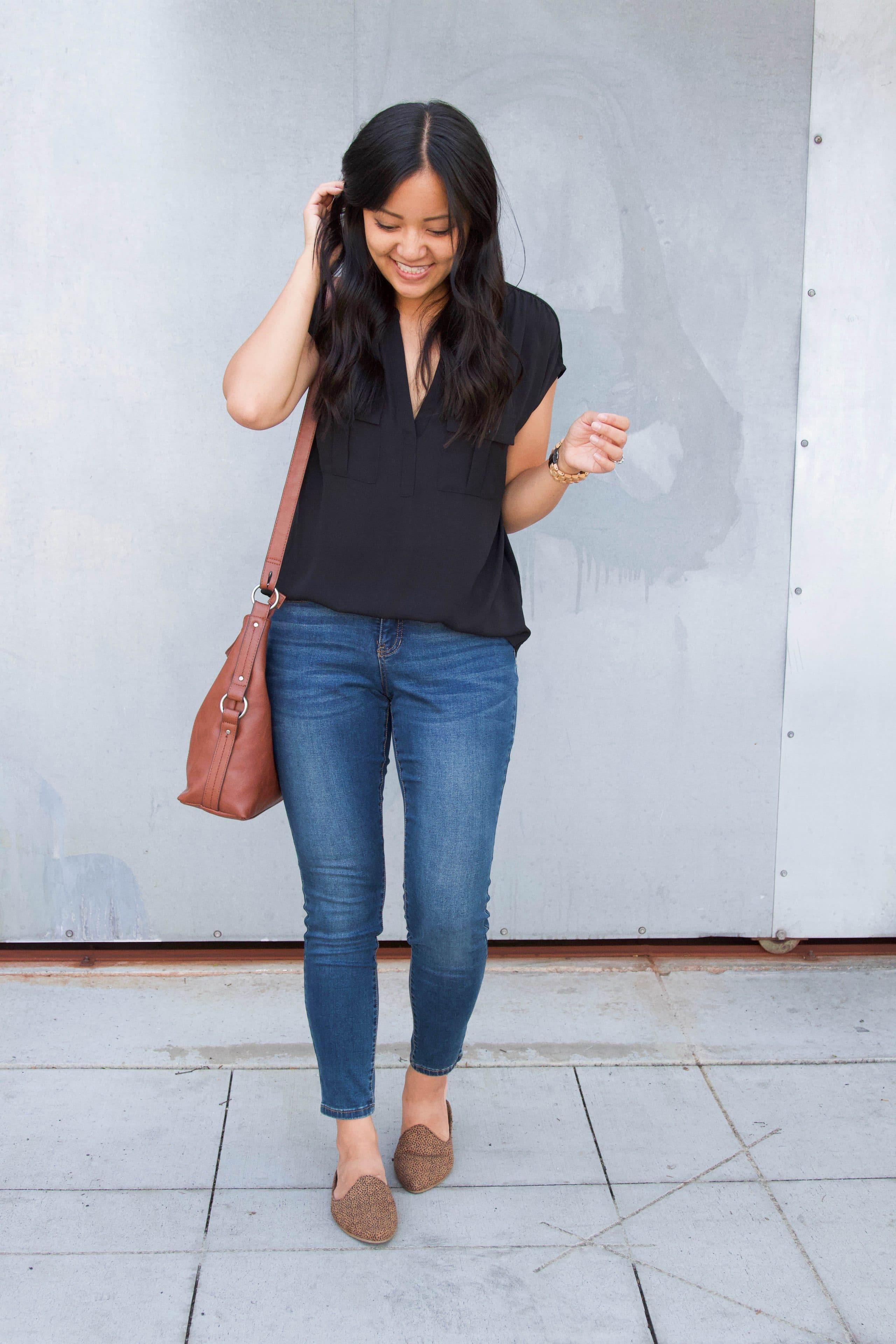 leopard mules + black top + skinny jeans + cognac purse