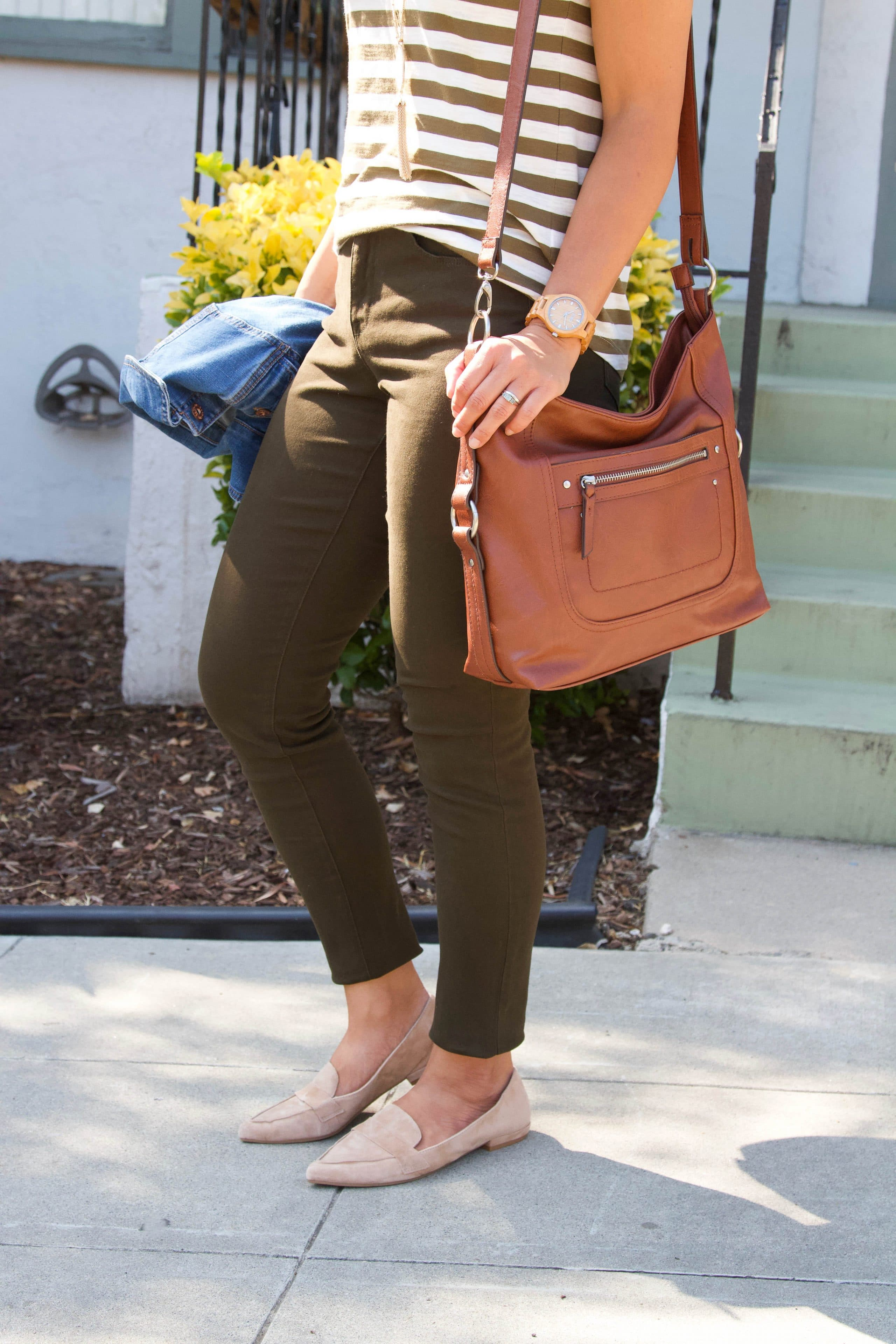 brown and white striped tee + brown pants + tan loafers + denim jacket + cognac purse