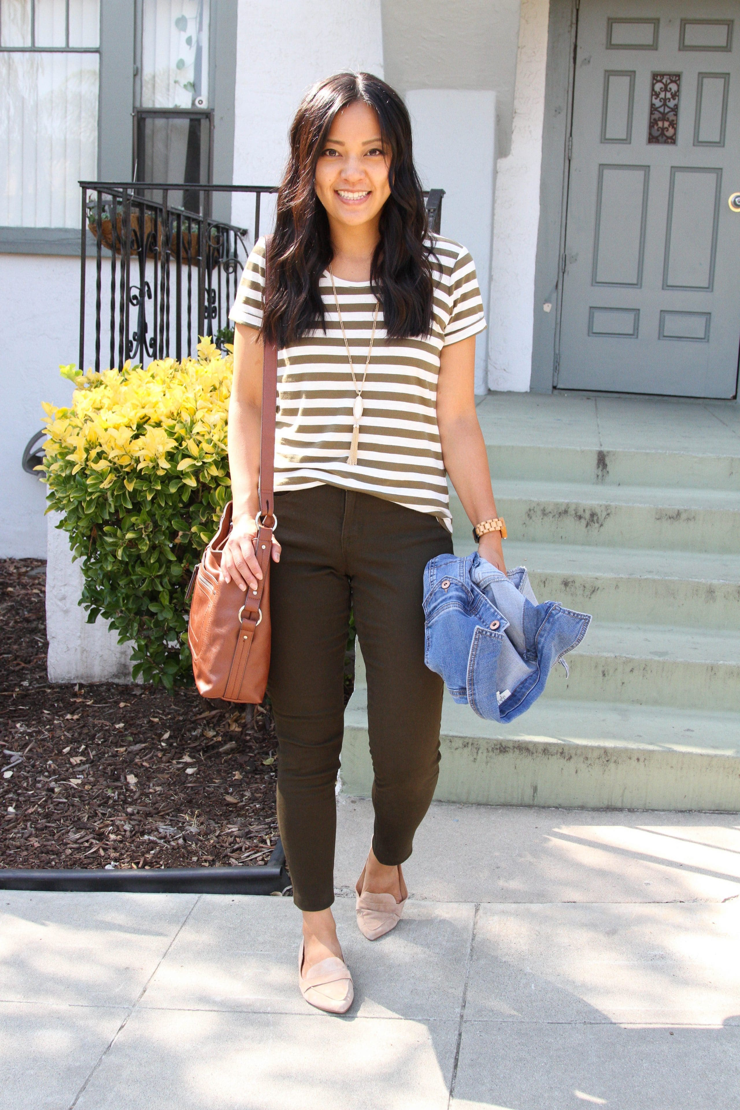 brown and white striped tee + brown pants + denim jacket + tan loafers + cognac purse