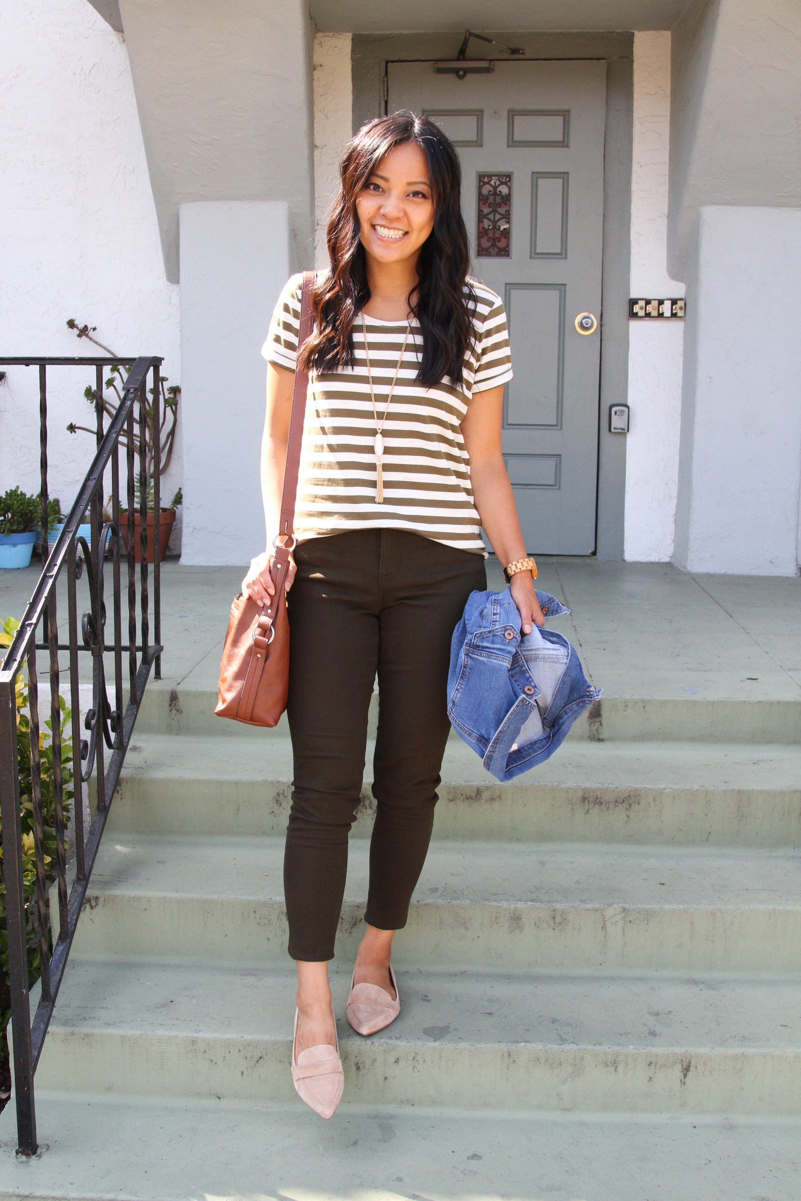 brown and white striped tee + tan loafers + brown pants + denim jacket + cognac purse